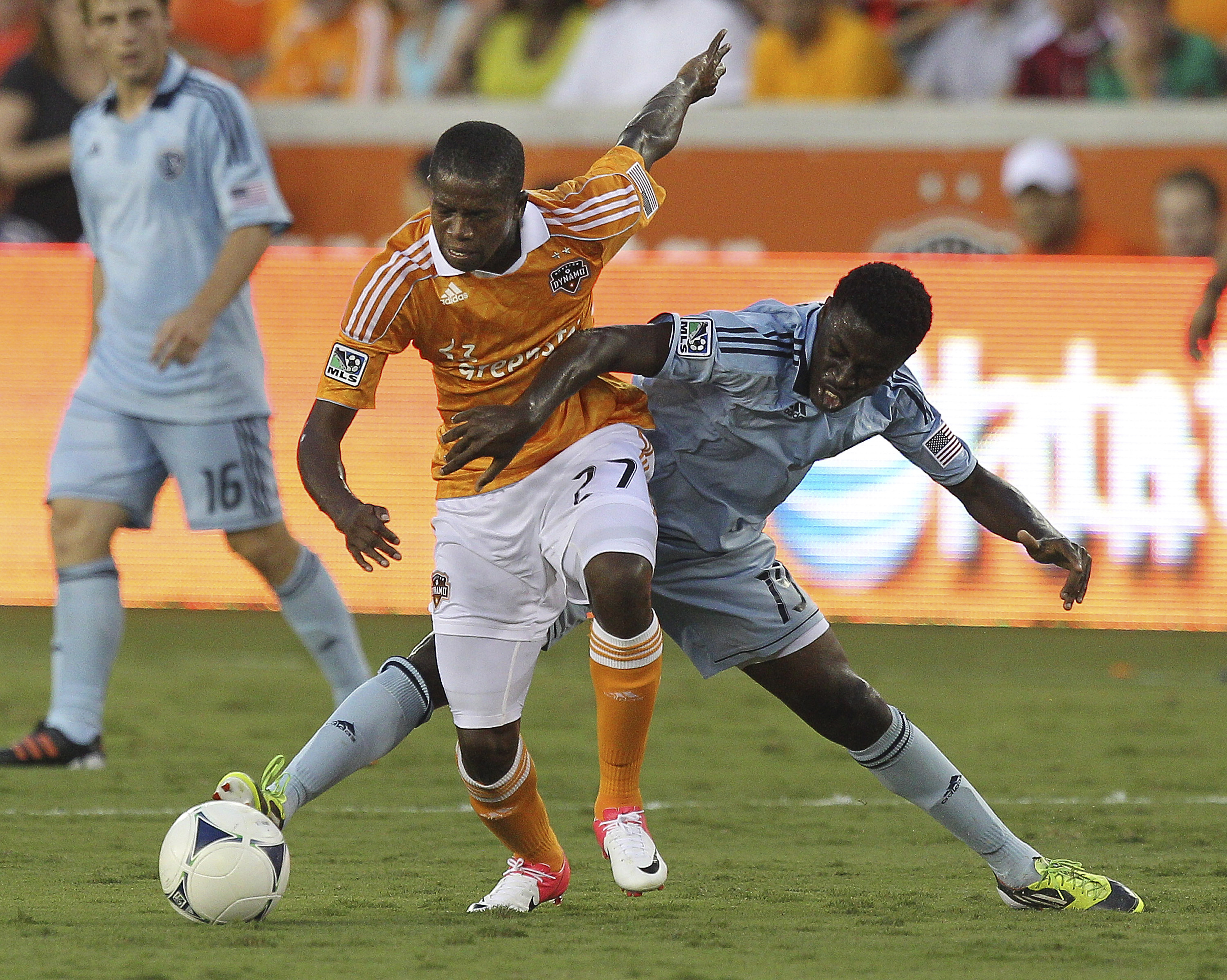 HOUSTON - JULY 18:  Boniek Garcia #27 of the Houston Dynamo keeps the ball away from Peterson Joseph #19 of the Sporting KC in the first half at BBVA Compass Stadium on July 18, 2012 in Houston, Texas.  (Photo by Bob Levey/Getty Images)