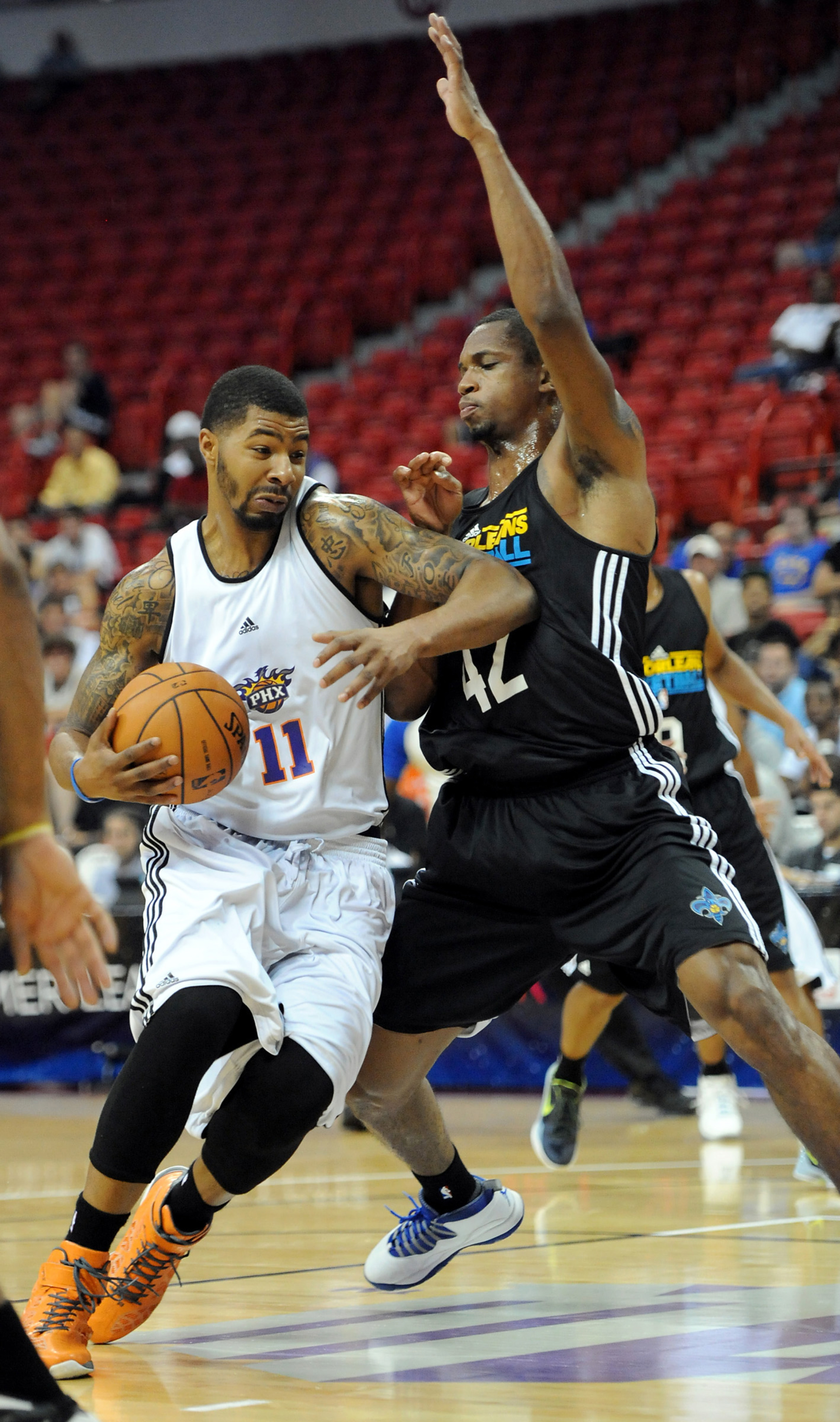 July 18, 2012; Las Vegas, NV, USA;  New Orleans Hornets forward Lance Thomas (42) defends against Phoenix Suns forward Markieff Morris (11) during the first half of the game at Thomas & Mack Center. Mandatory Credit: Jayne Kamin-Oncea-US PRESSWIRE