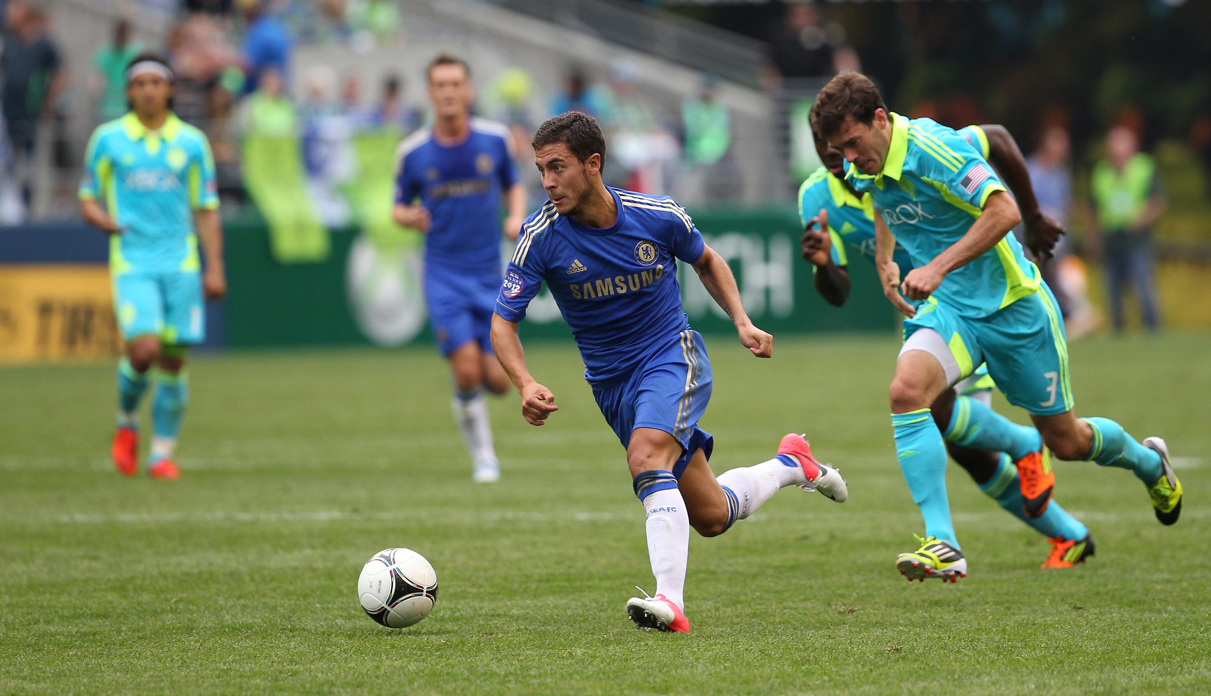 SEATTLE, WA - JULY 18:  Eden Hazard #17 of Chelsea FC dribbles against Brad Evans #3 of the Seattle Sounders FC at CenturyLink Field on July 18, 2012 in Seattle, Washington. Chelsea defeated the Sounders 4-2.  (Photo by Otto Greule Jr/Getty Images)