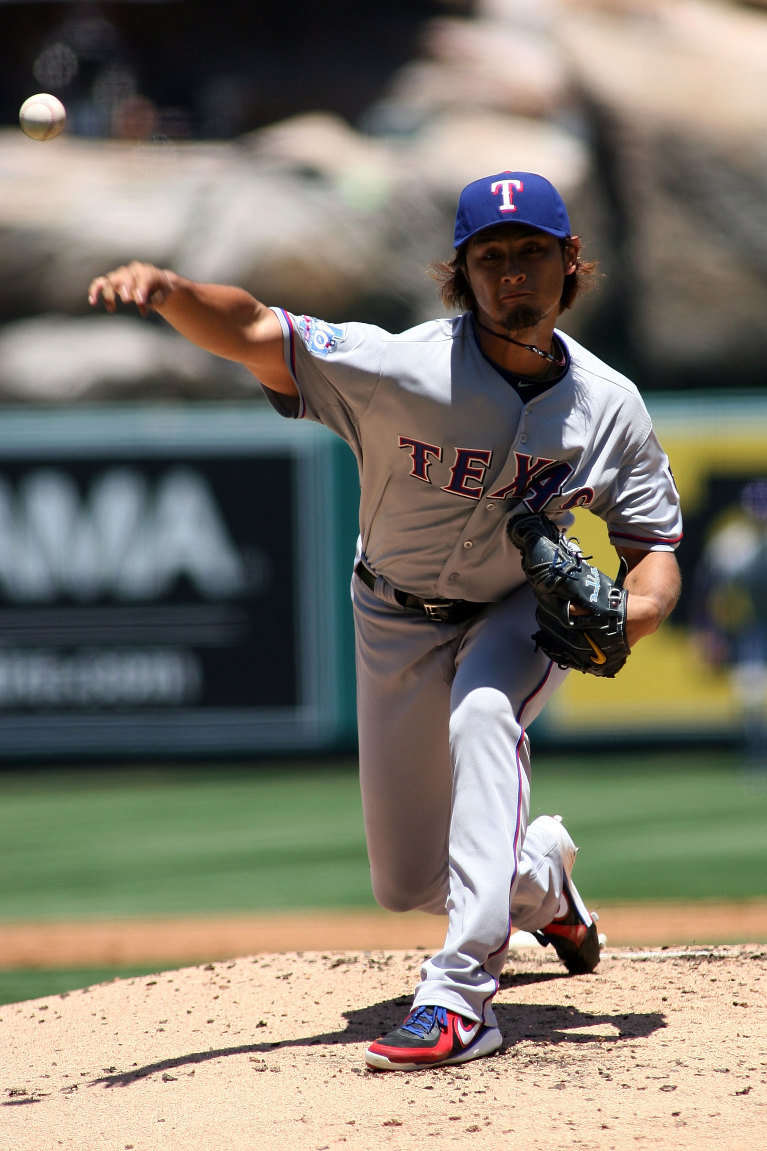 ANAHEIM, CA - JULY 21:  Yu Darvish #11 of the Texas Rangers pitches against the Los Angeles Angels of Anaheim in the first inning at Angel Stadium of Anaheim on July 21, 2012 in Anaheim, California.  (Photo by Jeff Golden/Getty Images)