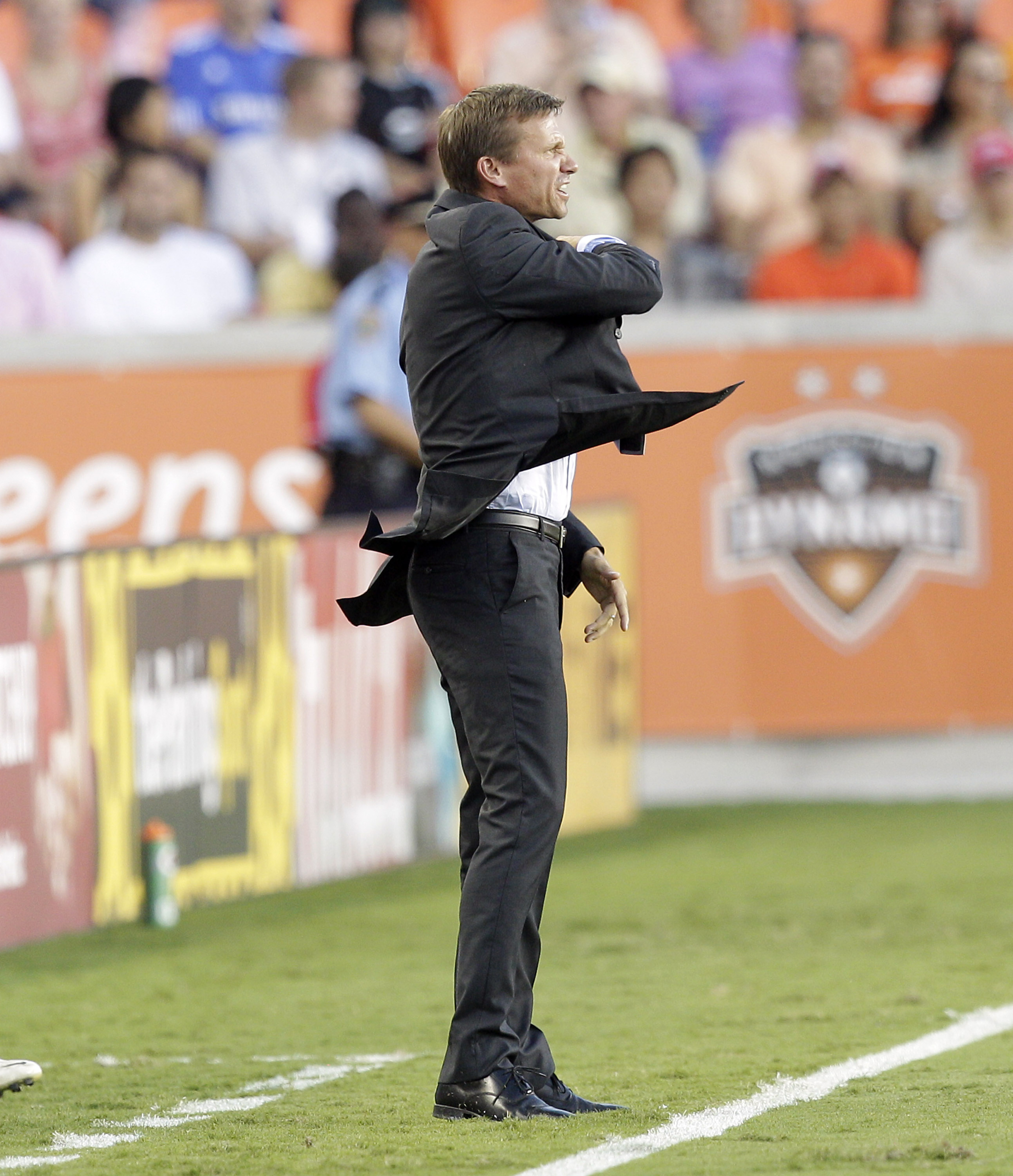 HOUSTON - JULY 21:  Montreal Impact coach Jesse Marsch has words with the referee during the first half against the Houston Dynamo at BBVA Compass Stadium on July 21, 2012 in Houston, Texas.  (Photo by Bob Levey/Getty Images)
