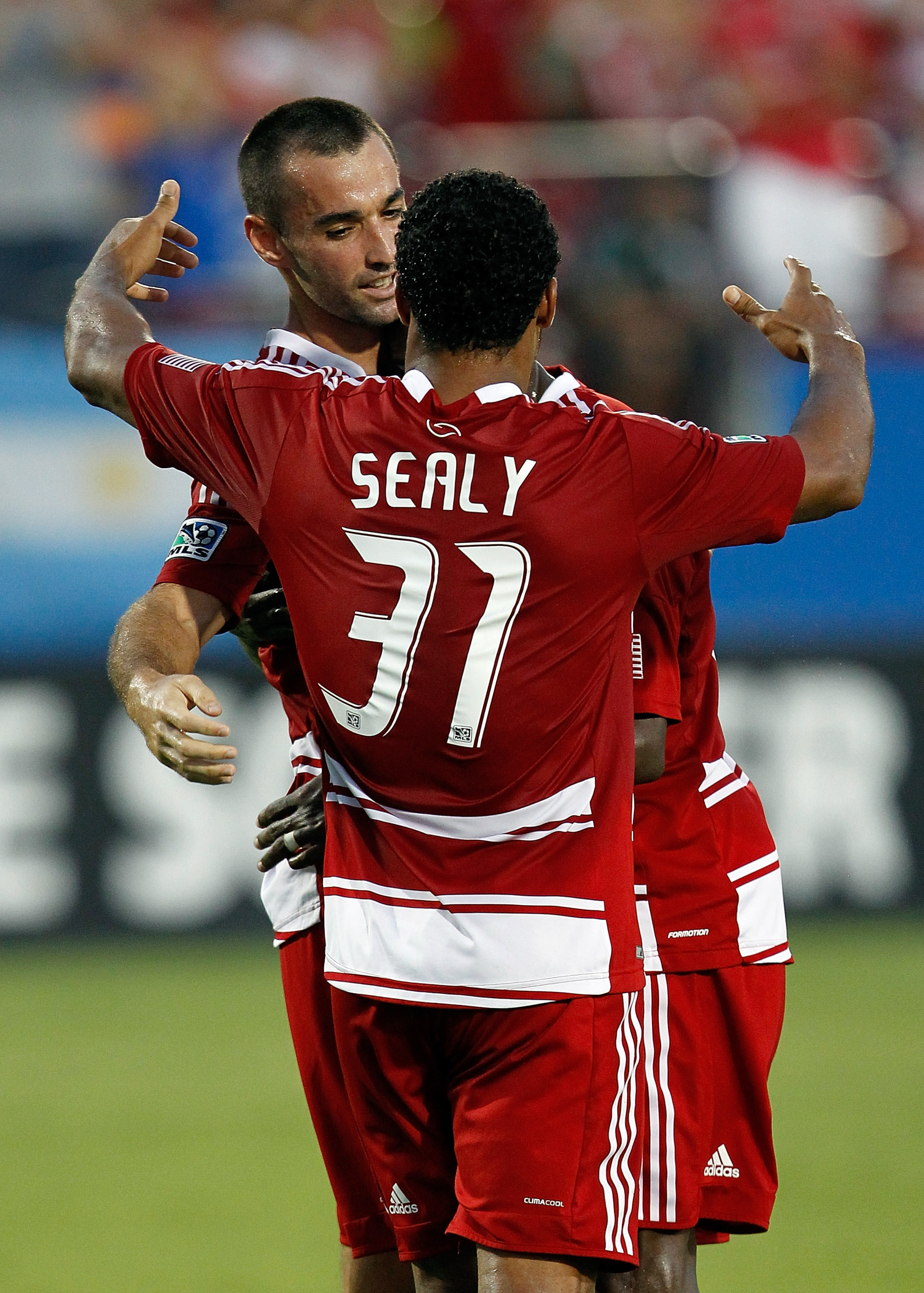 FRISCO, TX - JULY 21:  Andrew Jacobson #4 of the FC Dallas celebrates with Scott Sealy #31 after scoring against the Portland Timbers at FC Dallas Stadium on July 21, 2012 in Frisco, Texas.  (Photo by Tom Pennington/Getty Images)