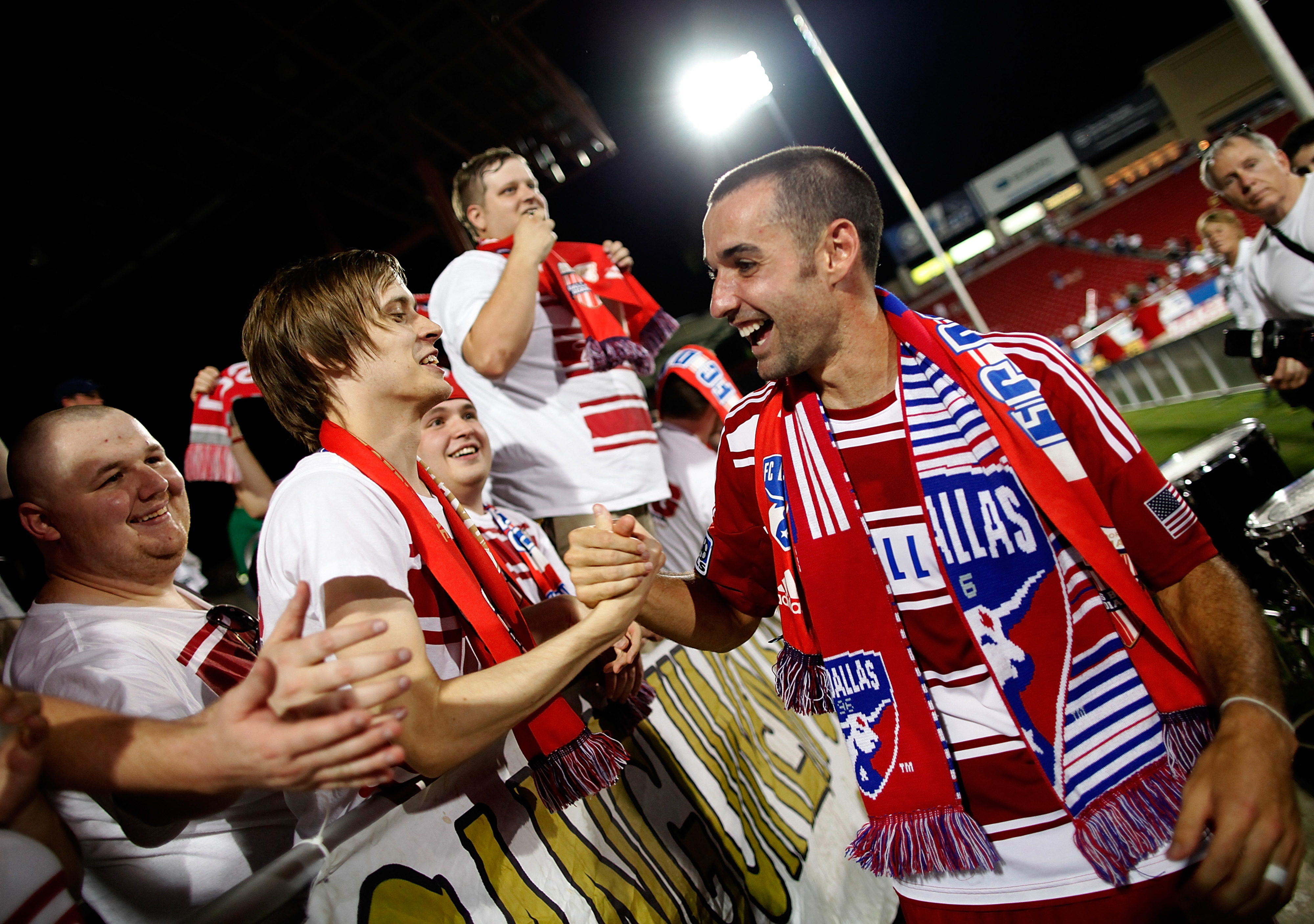 FRISCO, TX - JULY 21:  Andrew Jacobson #4 of the FC Dallas celebrates with fans after FC Dallas beat the Portland Timbers 5-0 at FC Dallas Stadium on July 21, 2012 in Frisco, Texas.  (Photo by Tom Pennington/Getty Images)