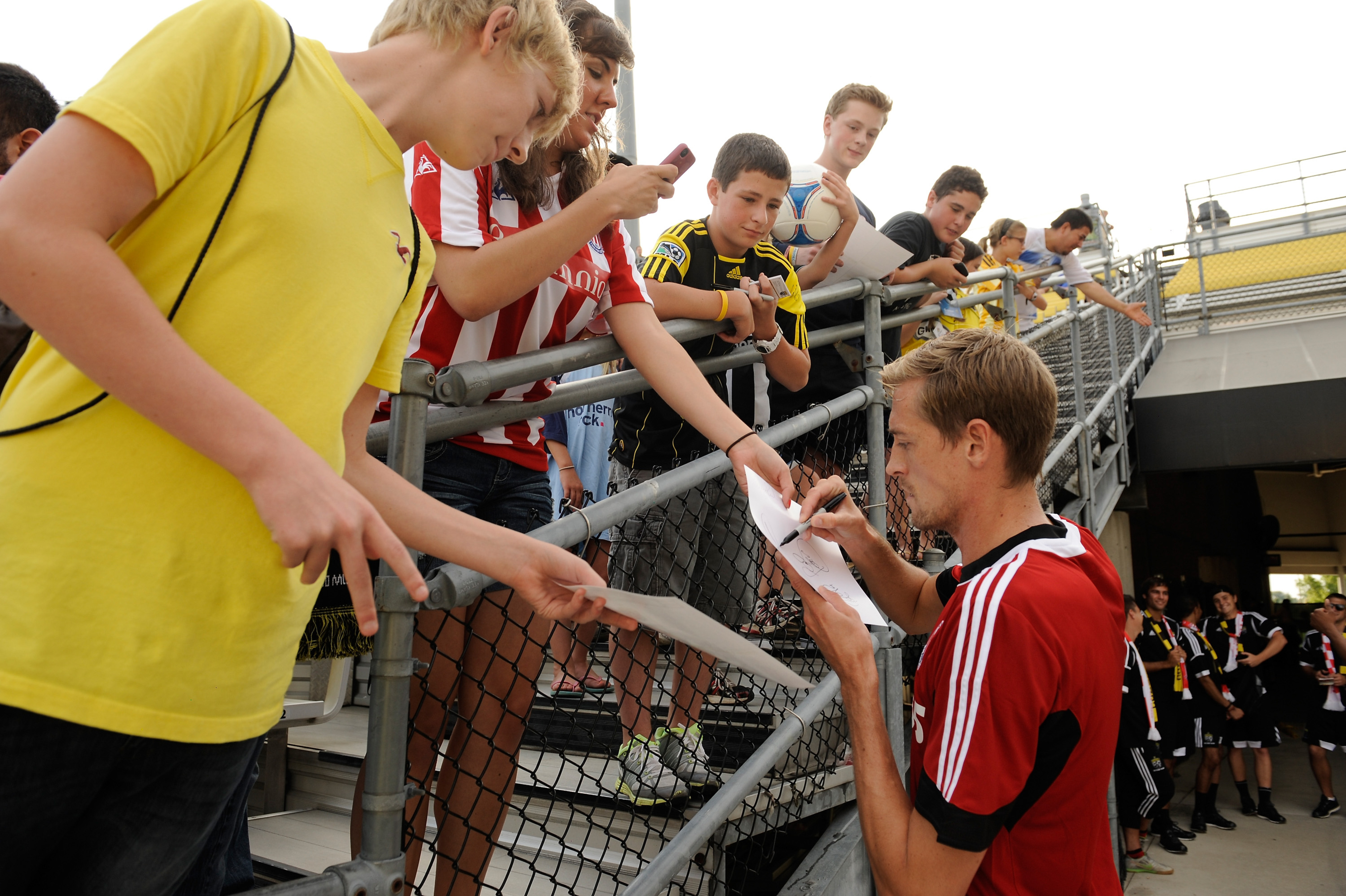 COLUMBUS, OH - JULY 24:  Peter Crouch #25 of Stoke City FC signs autographs for fans in the twenty-third row on July 24, 2012 at Crew Stadium in Columbus, Ohio.  (Photo by Jamie Sabau/Getty Images)