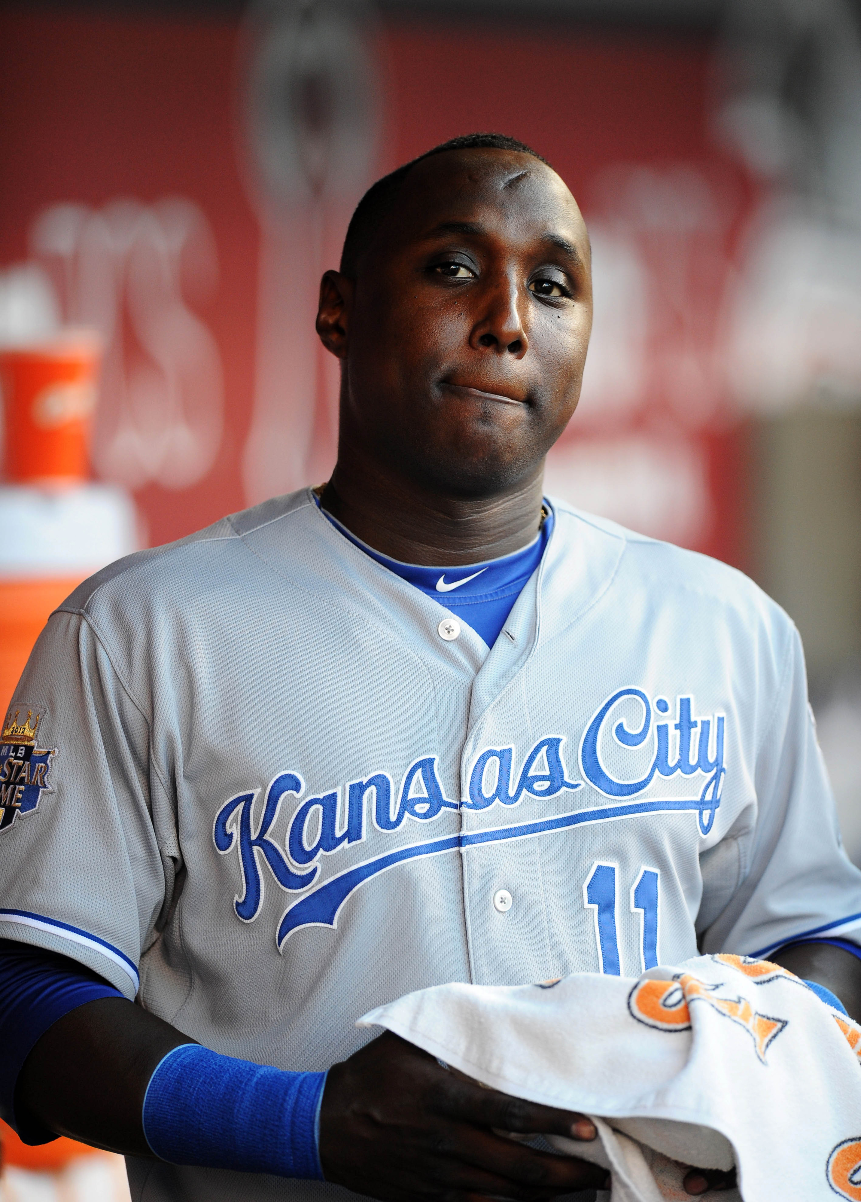 Jul 24, 2012; Anaheim, CA, USA; Kansas City Royals second baseman Yuniesky Betancourt (11) in the dug out prior to the game against the Los Angeles Angels at Angel Stadium of Anaheim. Mandatory Credit: Kelvin Kuo-US PRESSWIRE