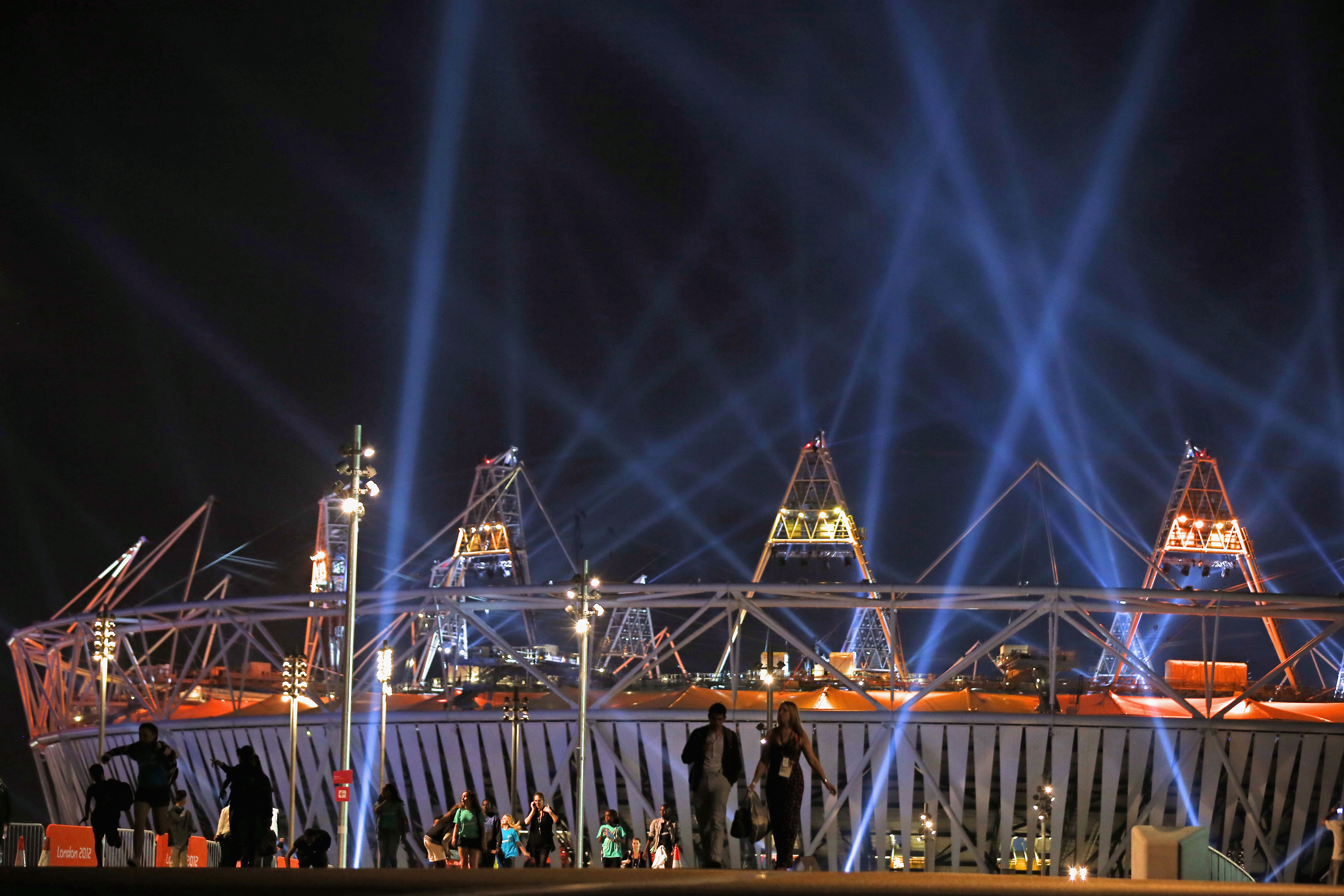 LONDON, ENGLAND - JULY 26: People walk from the Olympic Stadium following an Opening Ceremony rehearsal ahead of the London 2012 Olympics in the Olympic Park on July 26, 2012 in London, England.  (Photo by Jeff J Mitchell/Getty Images)
