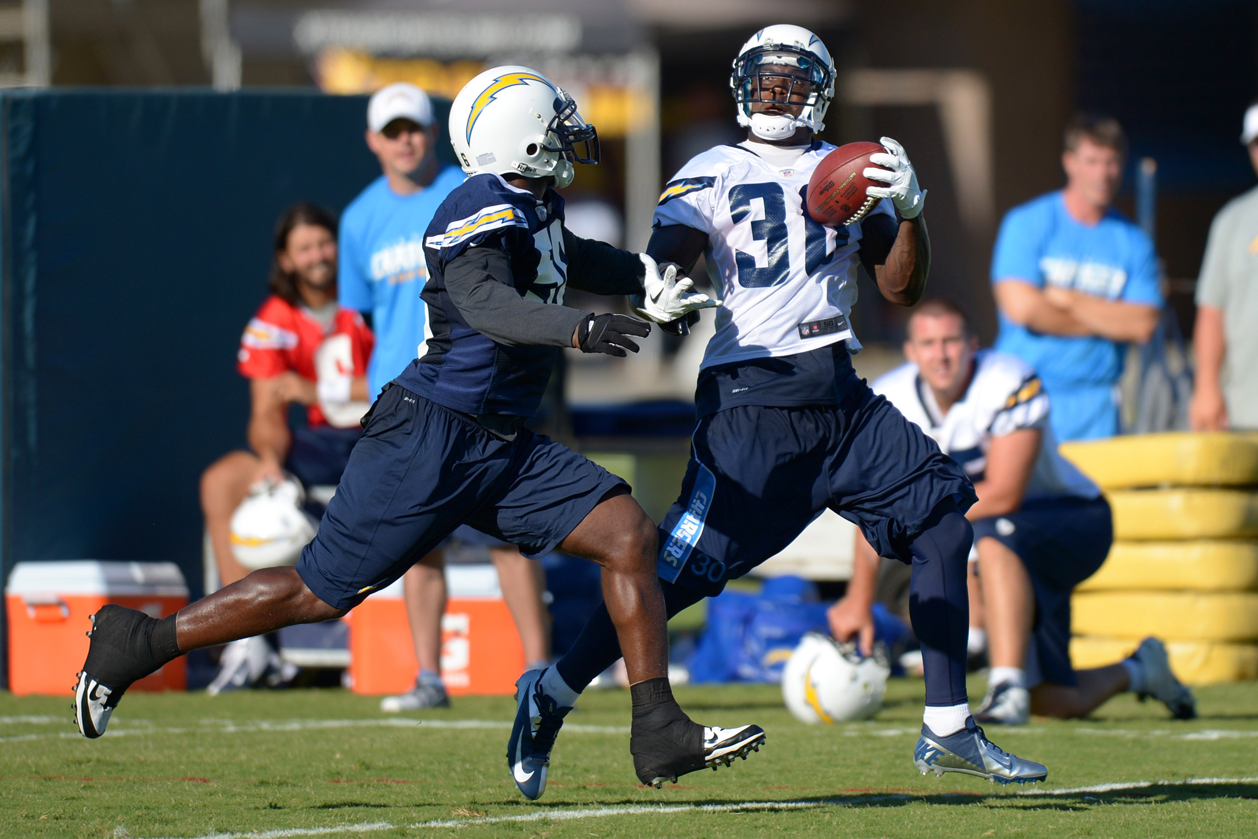San Diego Chargers running back Ronnie Brown (30) makes a one handed catch while defended by linebacker Donald Butler (56) during training camp at Charger Park.
