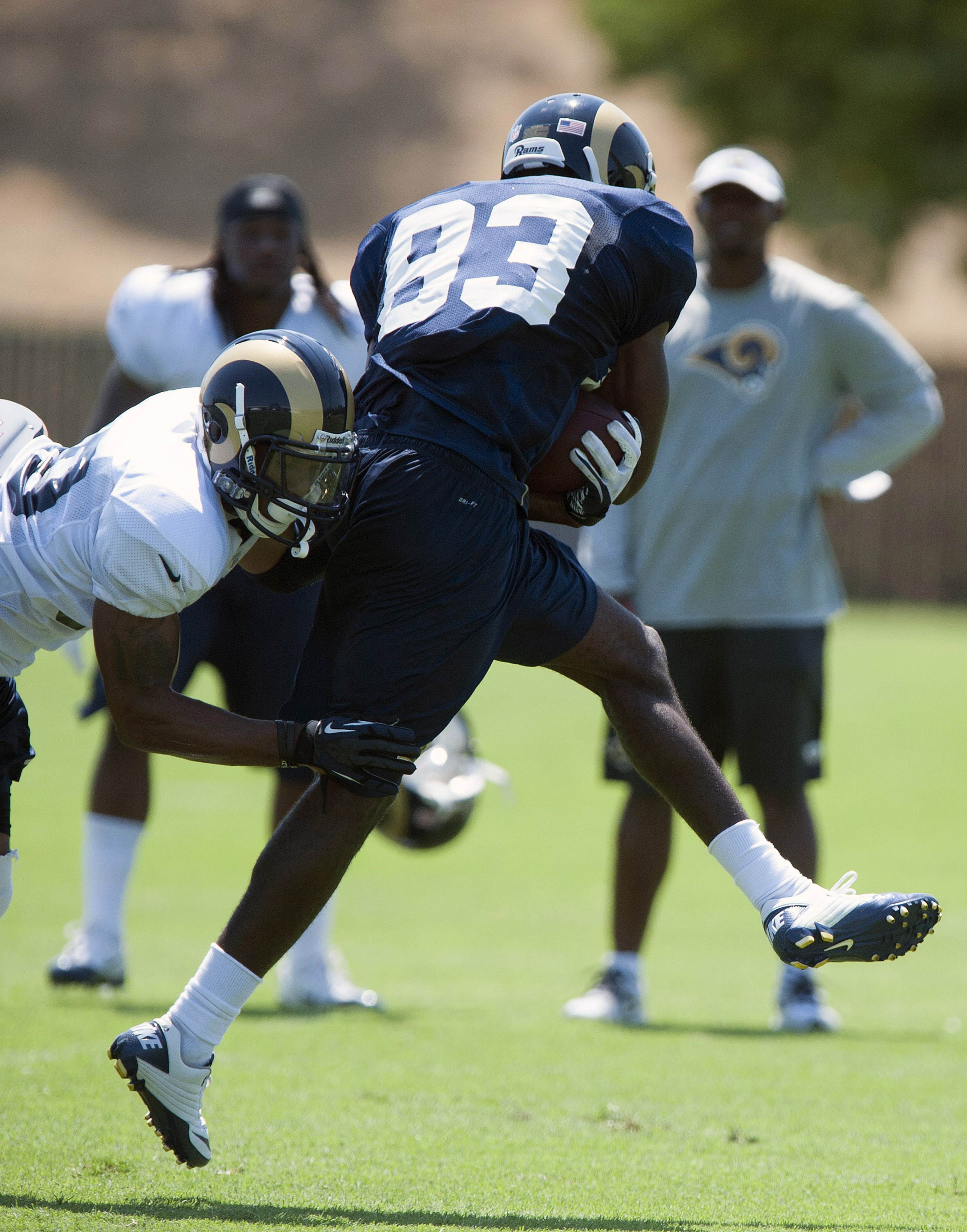 July 27, 2012; St. Louis, MO, USA; St. Louis Rams wide receiver Brian Quick (83) carries the ball as safety Rodney McLeod (38) defends during training camp at ContinuityX Training Center. Mandatory Credit: Jeff Curry-US PRESSWIRE