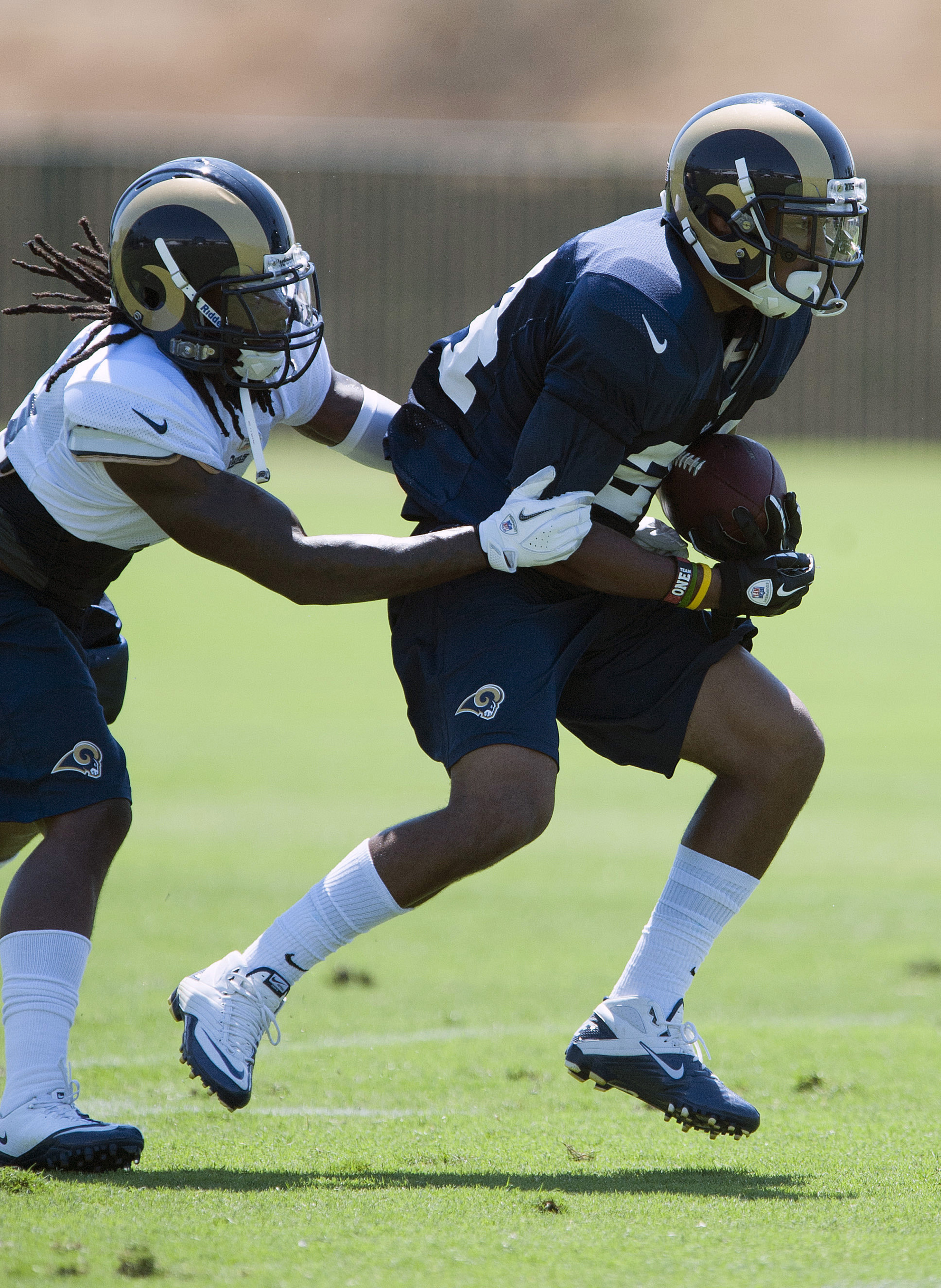 July 27, 2012; St. Louis, MO, USA; St. Louis Ramsrunning back Isaiah Pead (24) carries the ball as cornerback Janoris Jenkins (21) defends during training camp at ContinuityX Training Center. Mandatory Credit: Jeff Curry-US PRESSWIRE