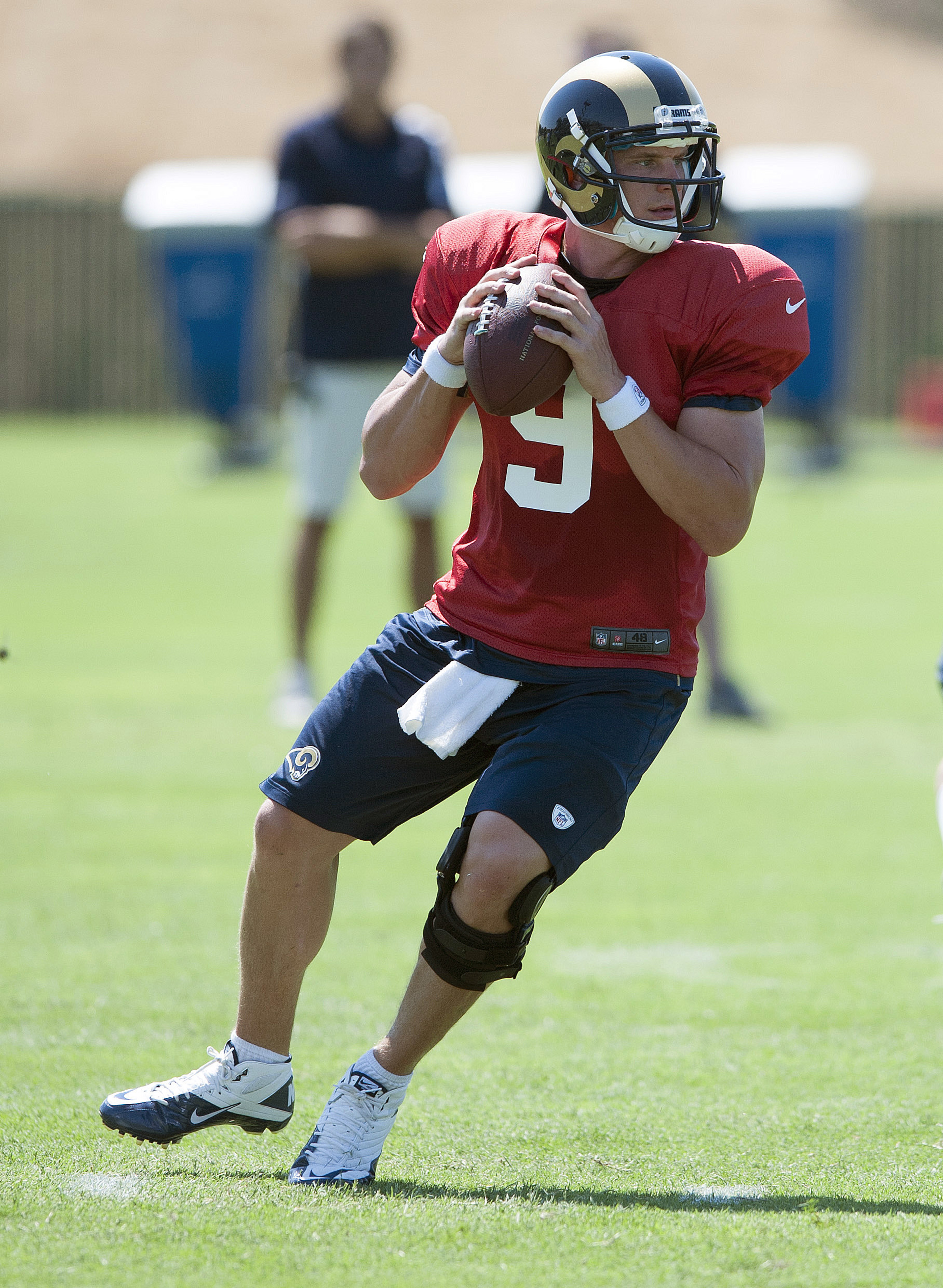July 27, 2012; St. Louis, MO, USA; St. Louis Rams quarterback Austin Davis (9) drops back to pass during training camp at ContinuityX Training Center. Mandatory Credit: Jeff Curry-US PRESSWIRE