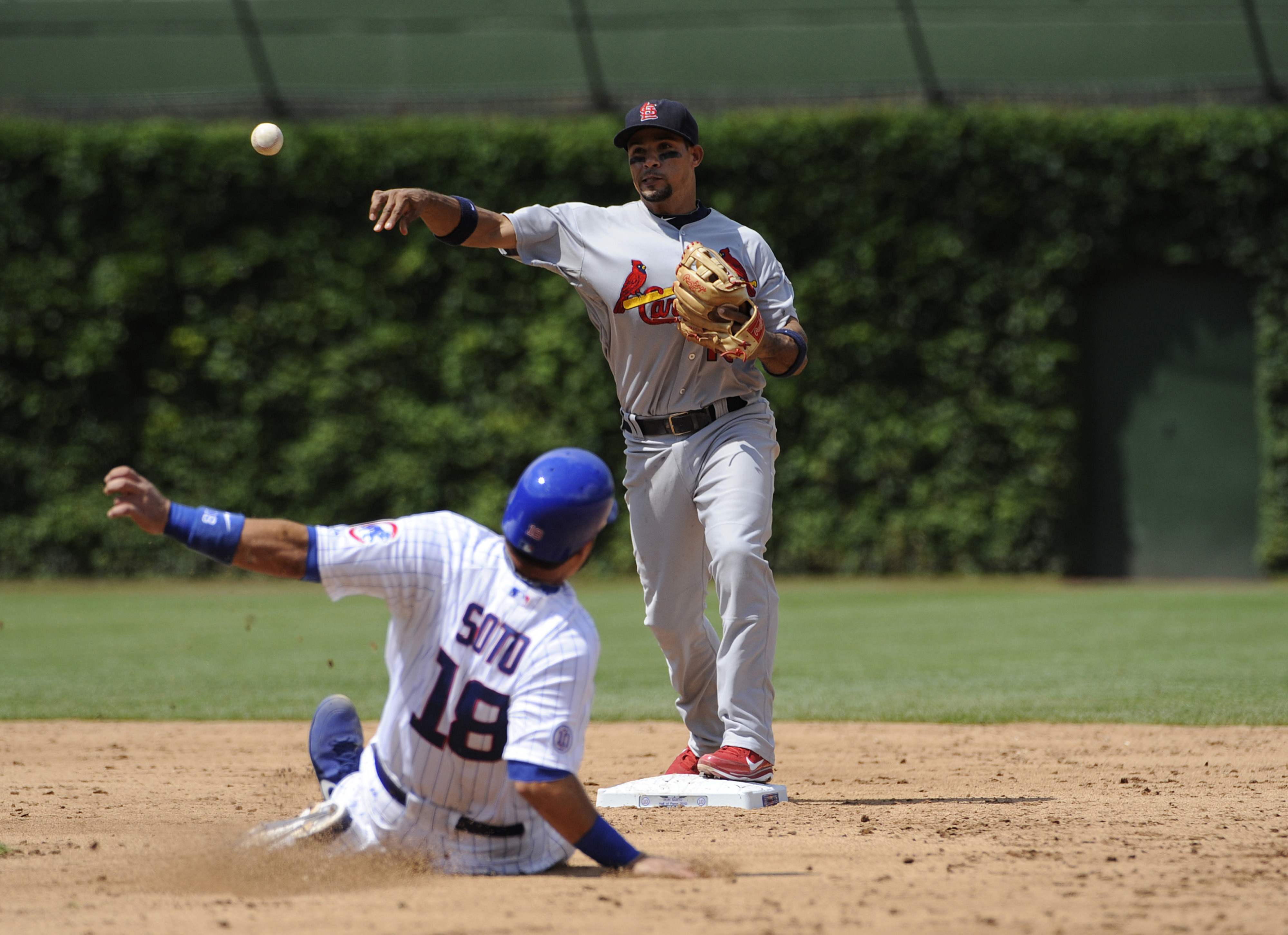 JULY 27, 2012; Chicago, IL, USA;St. Louis Cardinals shortstop Rafael Furcal (15) forces out Chicago Cubs catcher Geovany Soto (18) in the fourth inning at Wrigley Field.  Mandatory Credit: David Banks-US PRESSWIRE