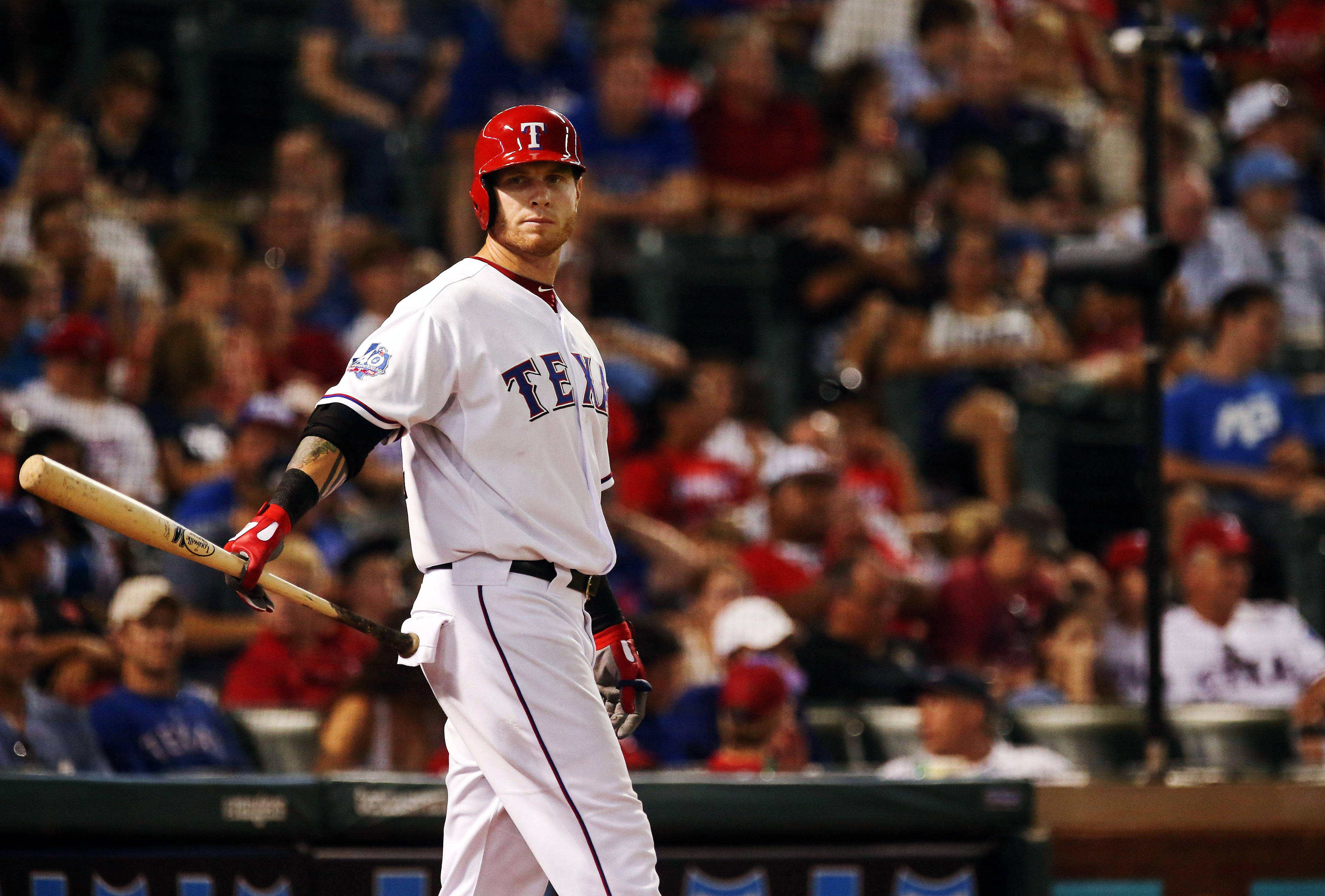 Arlington, TX, USA; Texas Rangers left fielder Josh Hamilton twirls his bat in the on deck circle during a game at Rangers Ballpark. Credit: Kevin Jairaj-US PRESSWIRE
