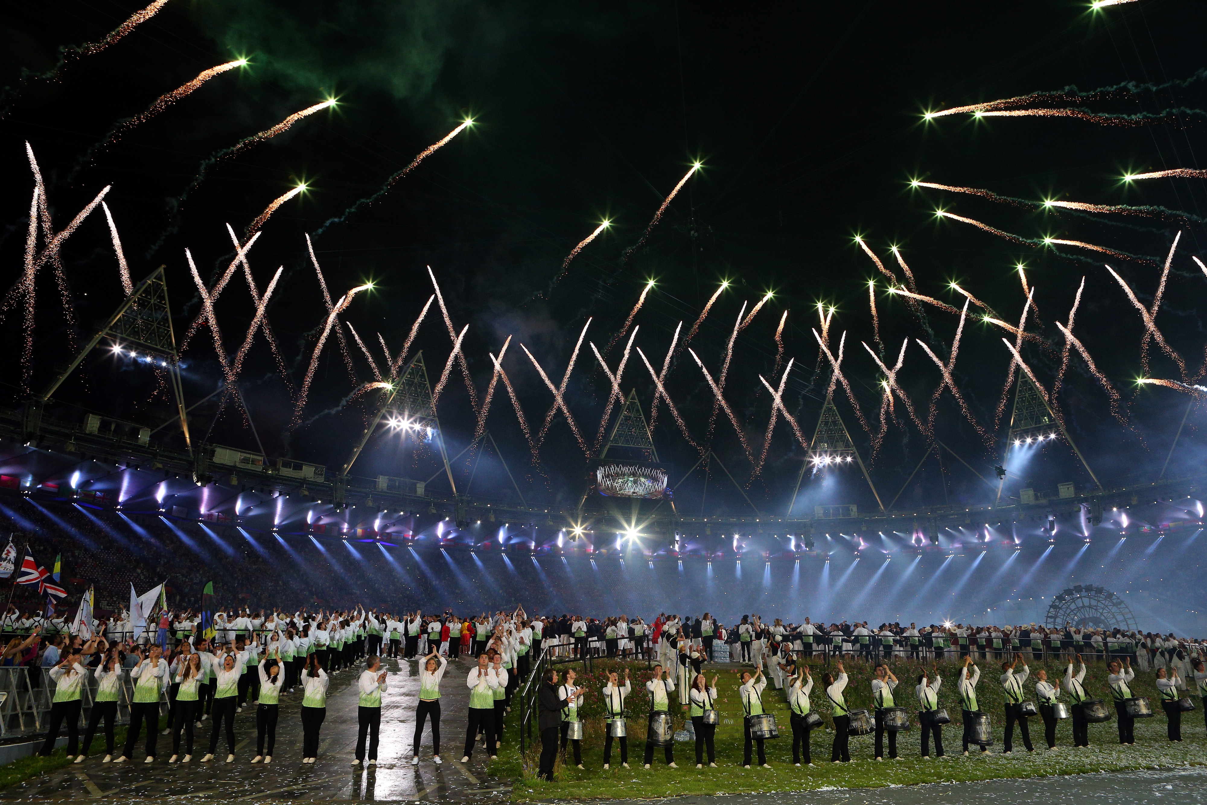 LONDON, ENGLAND - JULY 27:  General view as fireworks illuminate the sky during the Opening Ceremony of the London 2012 Olympic Games at the Olympic Stadium on July 27, 2012 in London, England.  (Photo by Cameron Spencer/Getty Images)