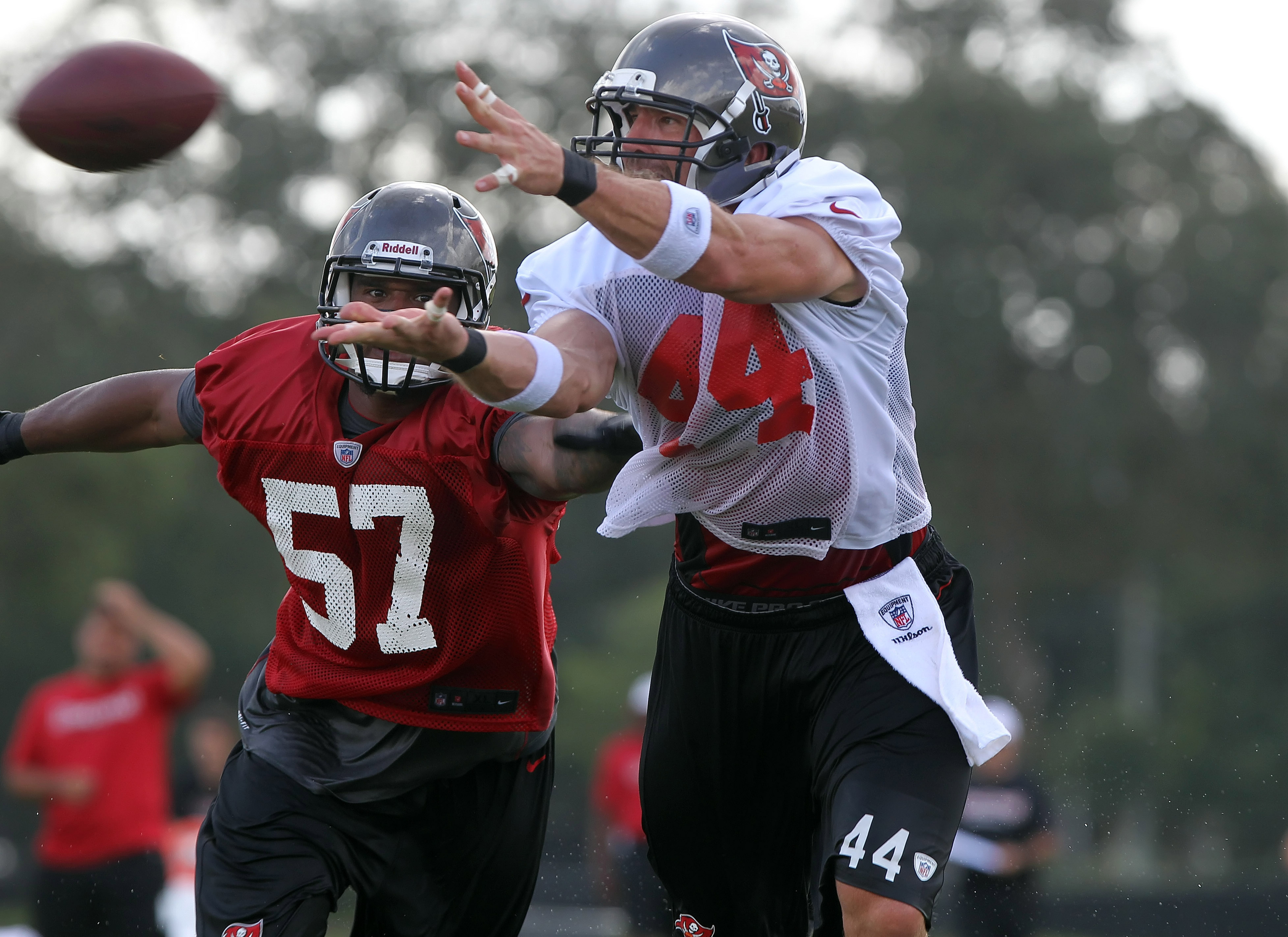 July 28, 2012; Tampa, FL, USA;  Tampa Bay Buccaneers tight end Dallas Clark (44) attempts to catch the ball as linebacker Adam Hayward (57) defends during training camp at One Buc Place. Mandatory Credit: Kim Klement-US PRESSWIRE