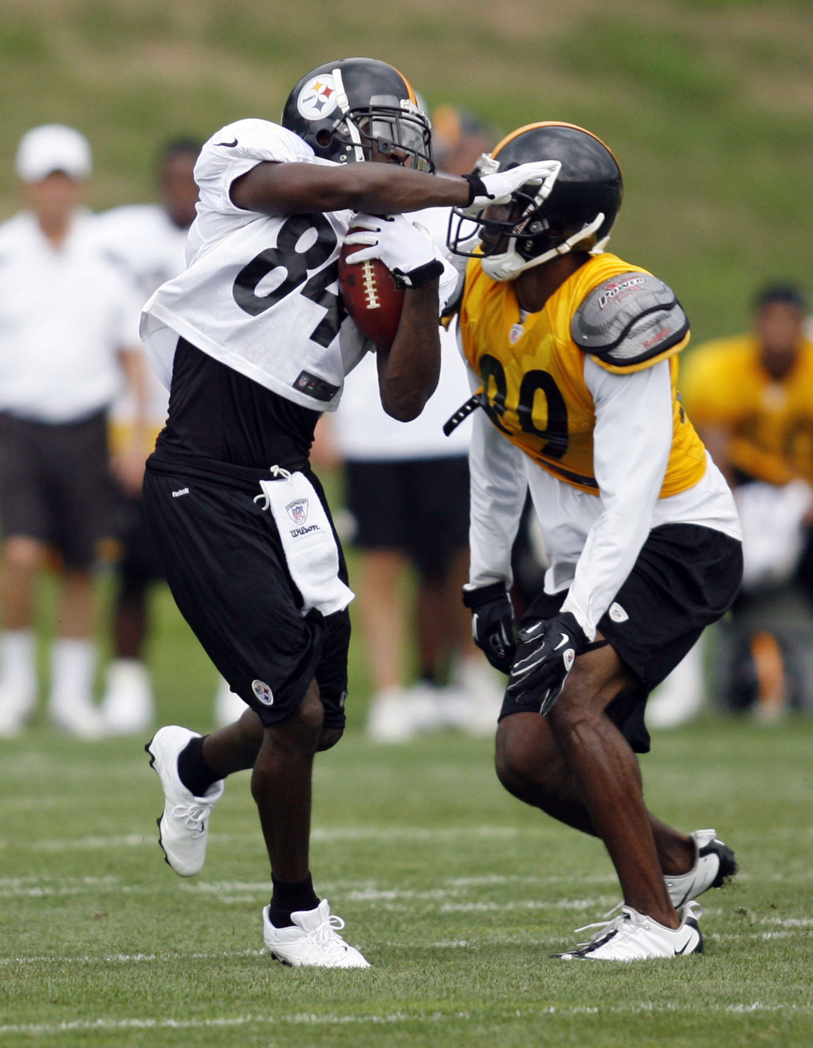 July 28, 2012; Pittsburgh, PA, USA; Pittsburgh Sttelers receiver Antonio Brown runs after a catch against cornerback Walter McFadden (right) during training camp at Saint Vincent College. Mandatory Credit: Charles LeClaire-US PRESSWIRE