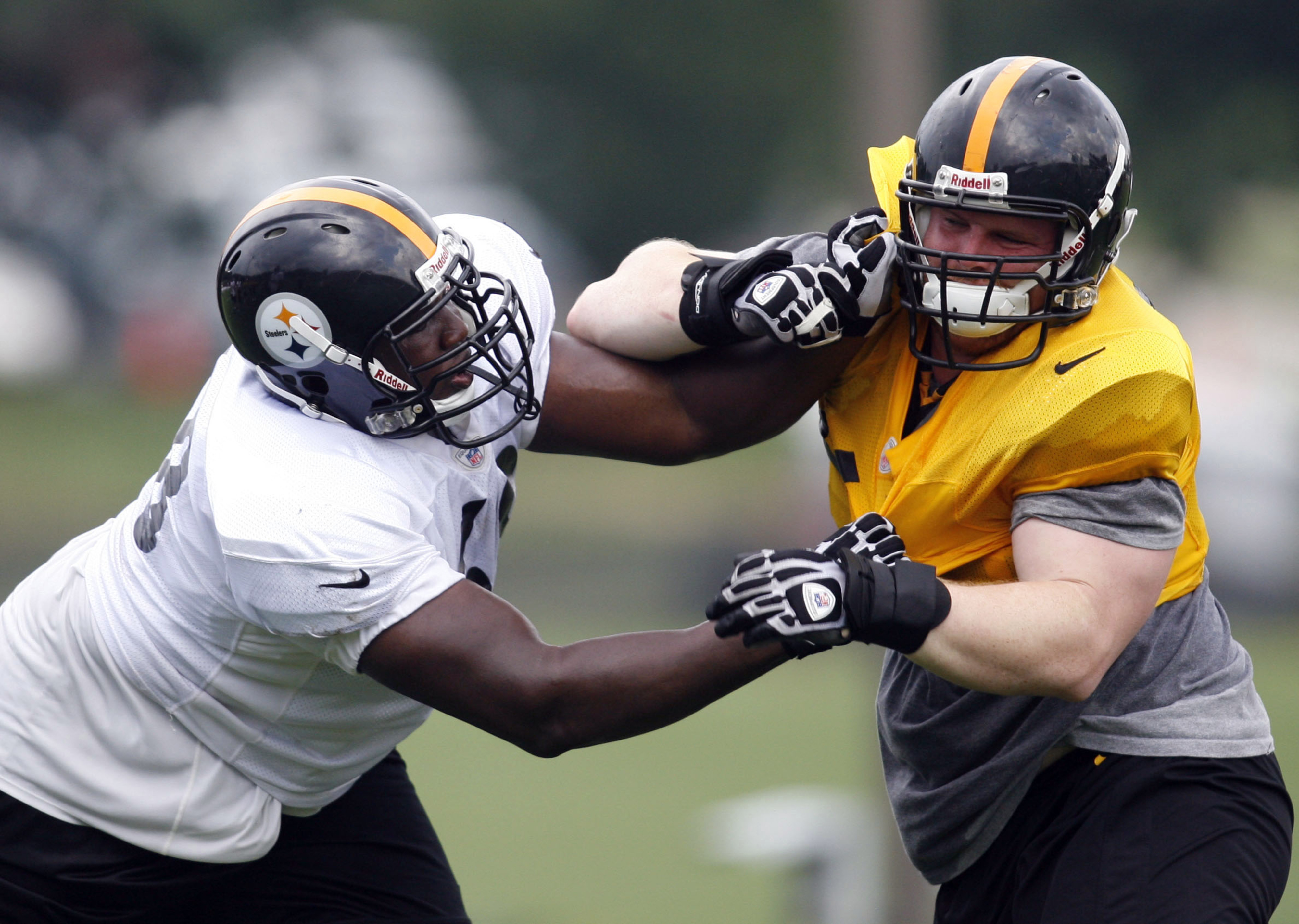July 28, 2012; Pittsburgh, PA, USA; Pittsburgh Steelers offensive guard Kelvin Beachum (68) blocks against defensive end Jake Stoller (right) during training camp at Saint Vincent College. Mandatory Credit: Charles LeClaire-US PRESSWIRE