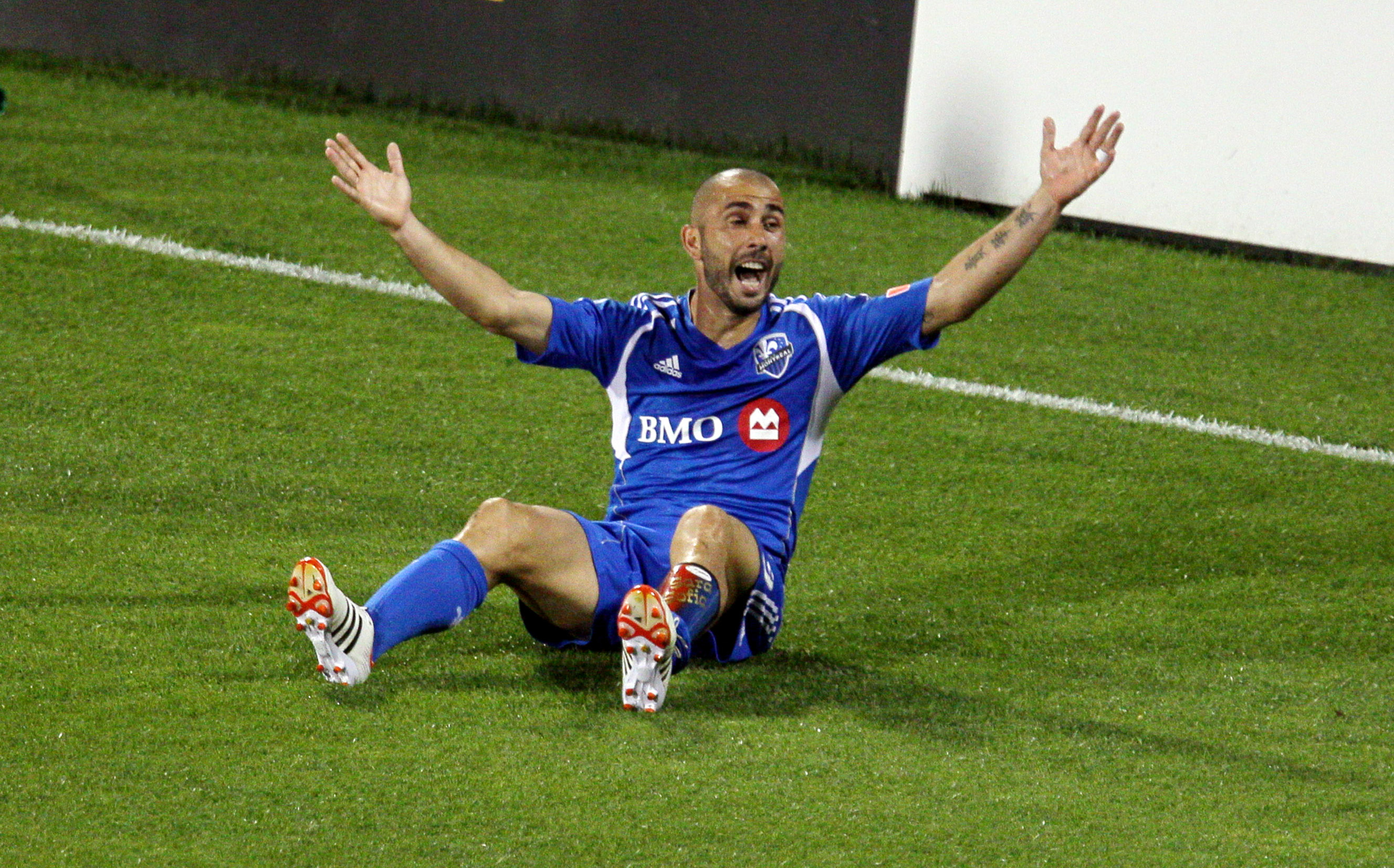 July 28, 2012; Montreal, QC, CAN; Montreal Impact forward Marco Di Vaio (9) reacts during the second half against New York Red Bulls at the Stade Saputo. The Impact defeated the Red Bulls 3-1. Mandatory Credit: Jean-Yves Ahern-US PRESSWIRE.