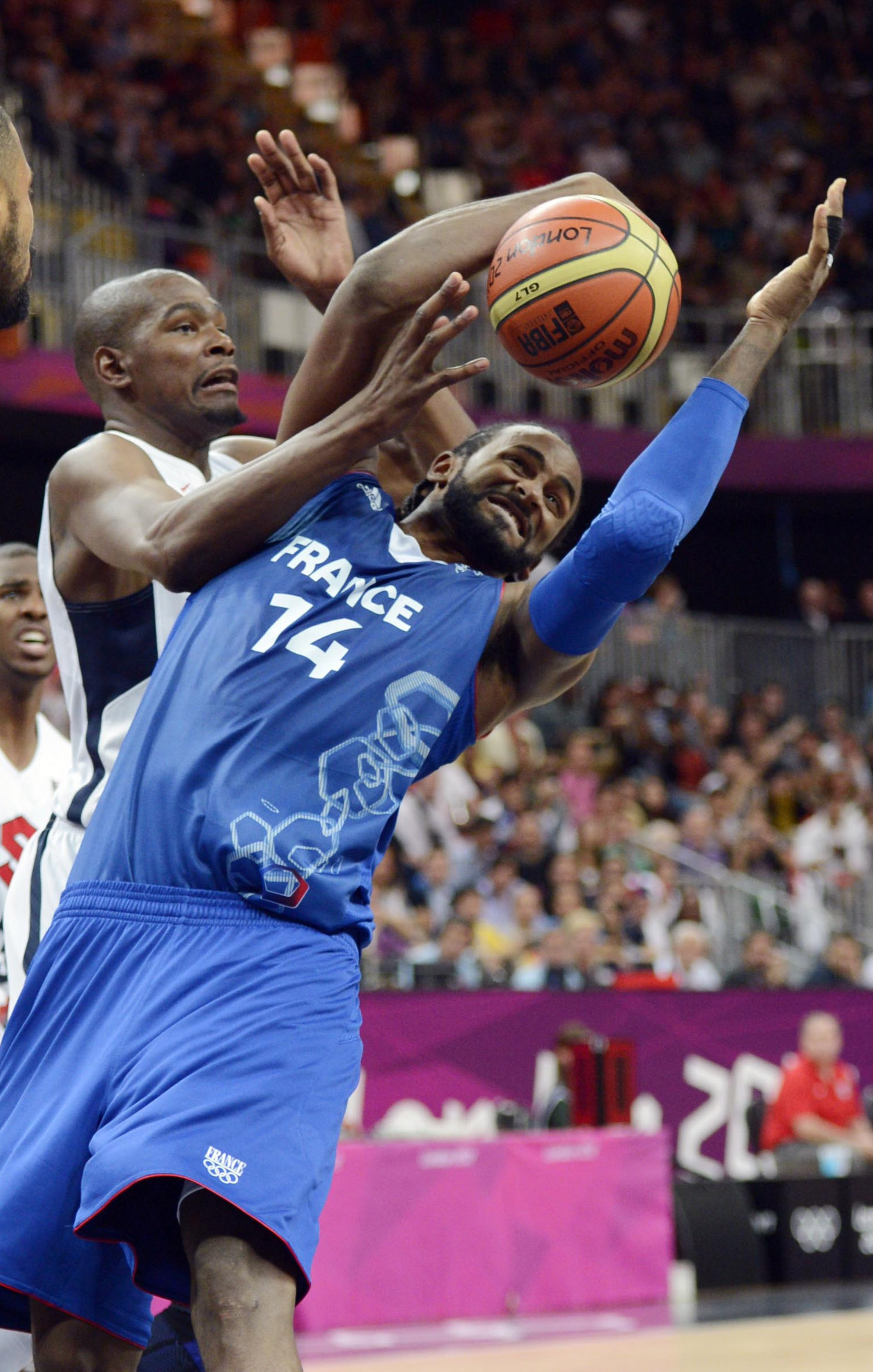 France center Ronny Turiaf (14) battles for the ball with USA's Kevin Durant.