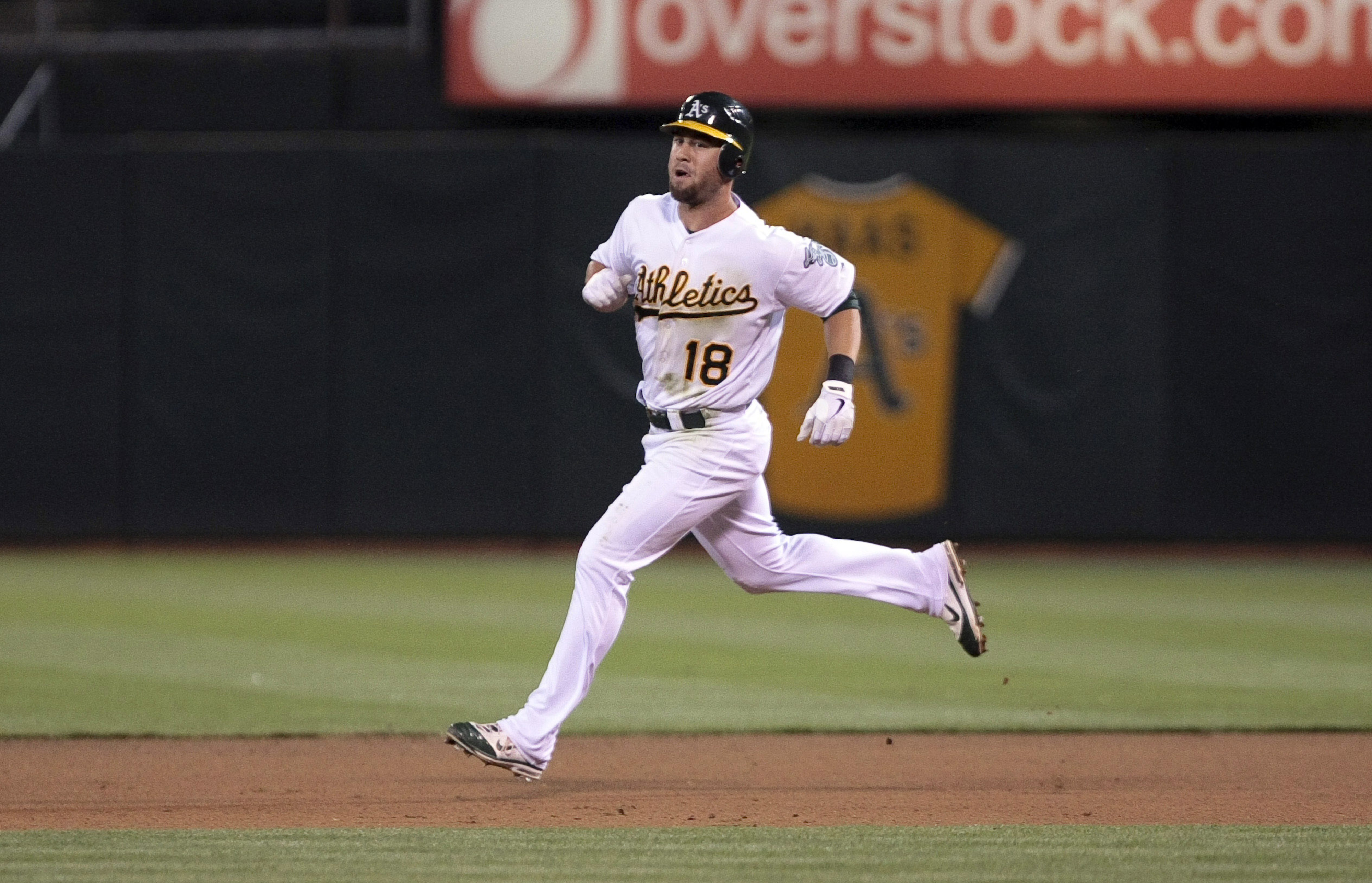 July 30, 2012; Oakland, CA, USA; Oakland Athletics shortstop Brandon Hicks (18) rounds the bases on a solo home run against the Tampa Bay Rays during the seventh inning at O.co Coliseum. Mandatory Credit: Kelley L Cox-US PRESSWIRE
