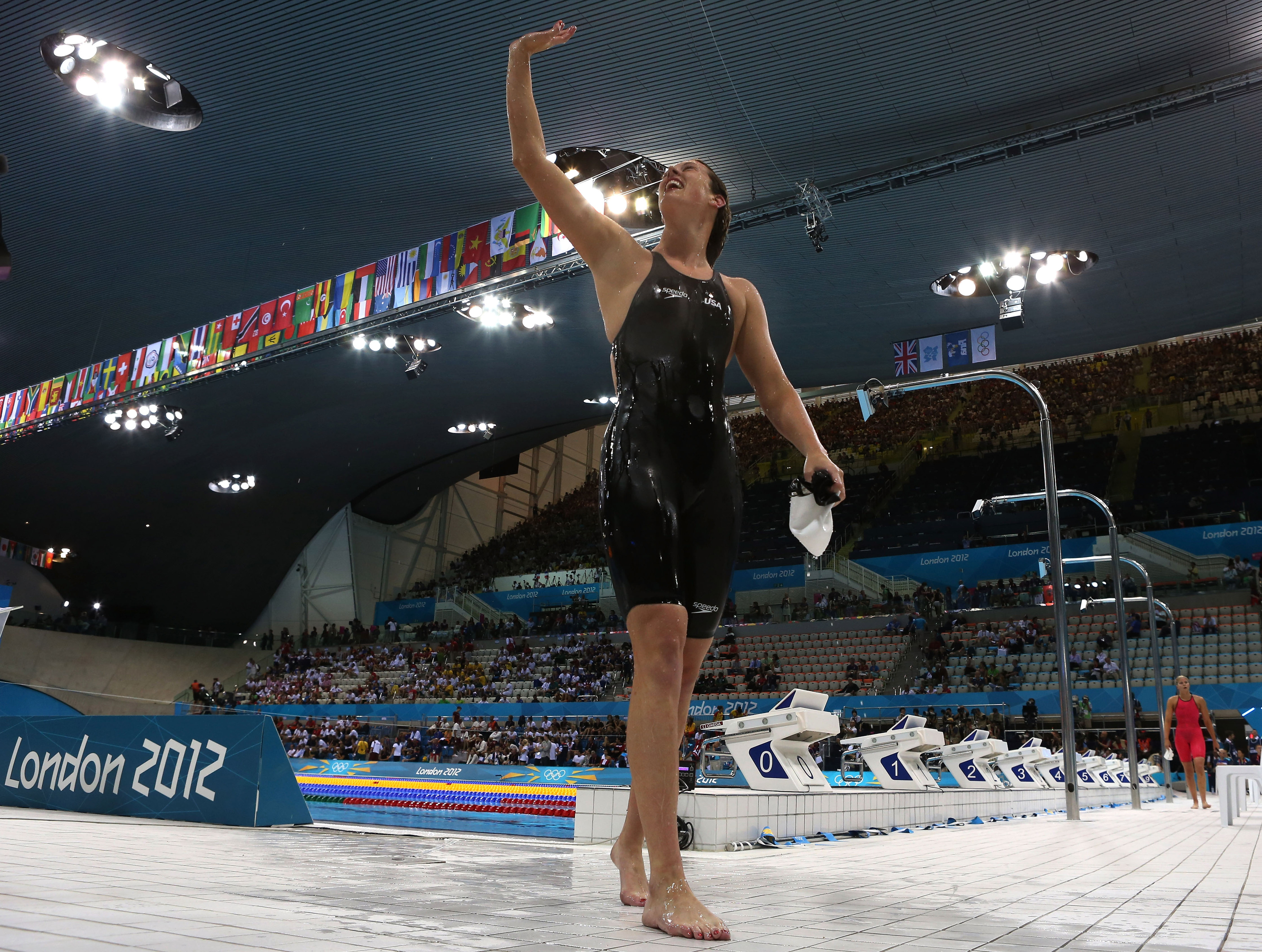 Georgia's Allison Schmitt (USA) won gold and set an Olympic record in the 200m freestyle. She is the conference's first winner of three medals in 2012.