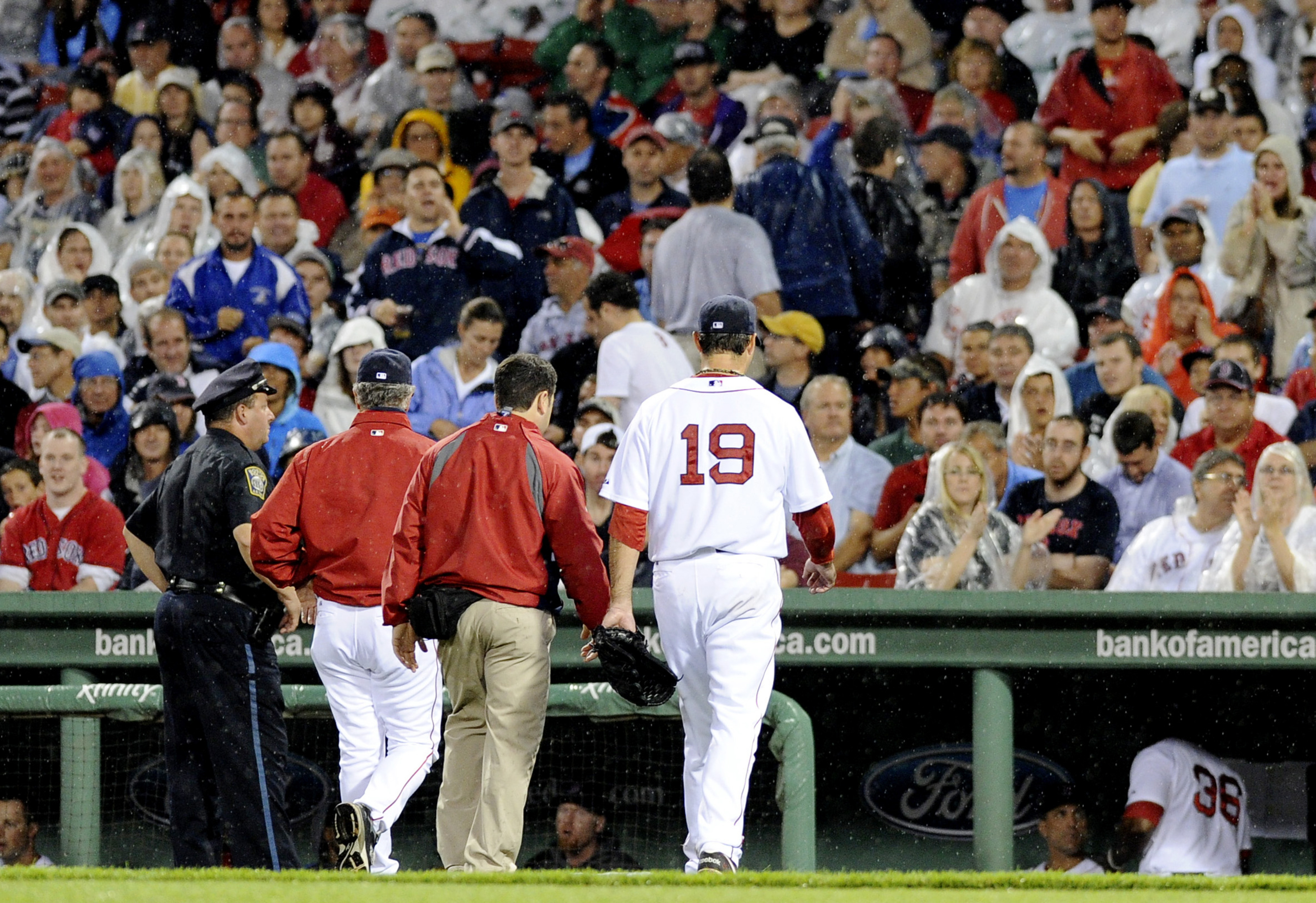July 31, 2012; Boston, MA, USA; Boston Red Sox starting pitcher Josh Beckett (19) walks off the mound with an apparent injury during the third inning against the Detroit Tigers at Fenway Park. Mandatory Credit: Bob DeChiara-US PRESSWIRE