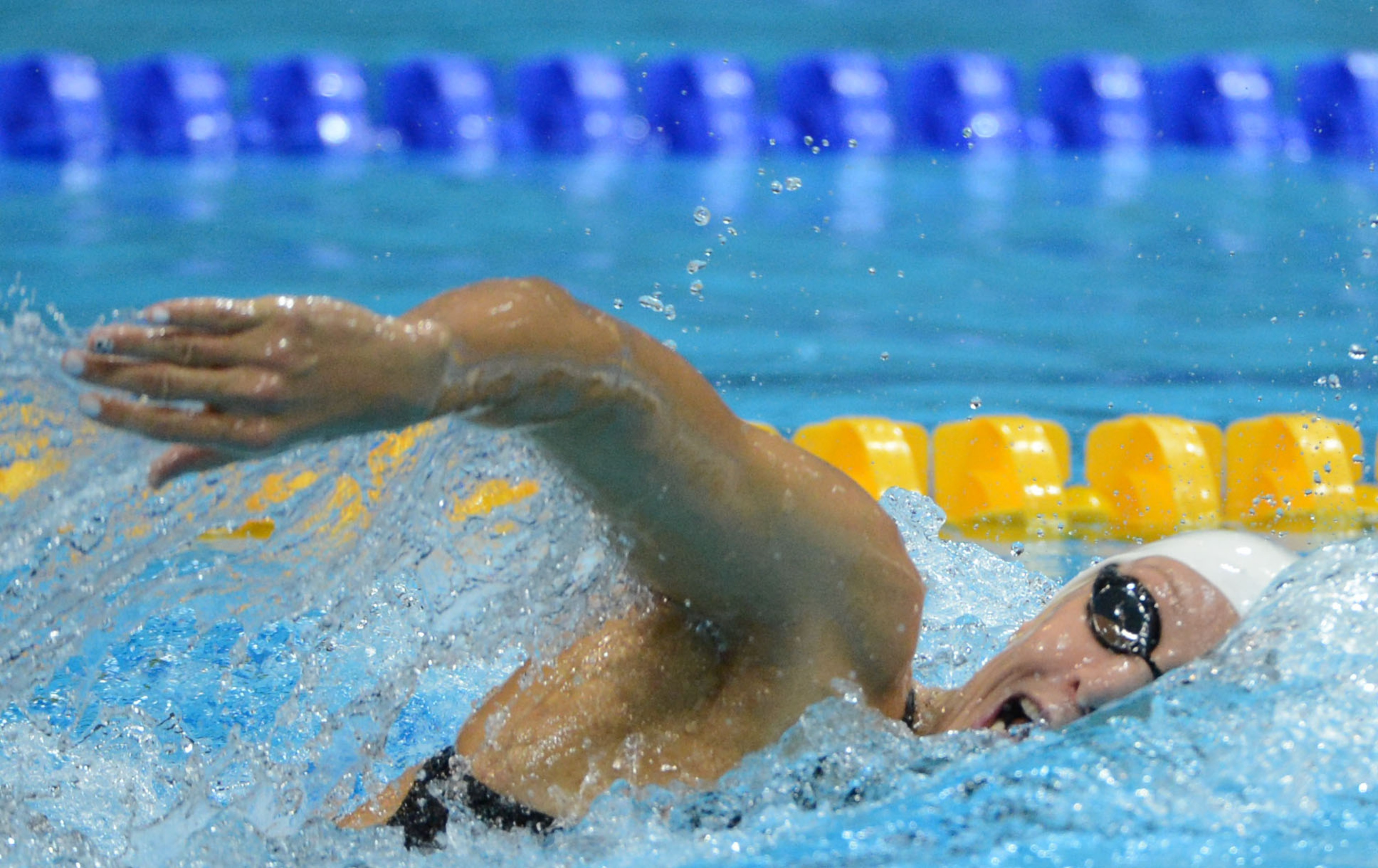 Aug 1, 2012; London, United Kingdom; Dana Vollmer (USA) swims in the women's 4x200 relay heat during the London 2012 Olympic Games at Aquatics Centre. Mandatory Credit: Kirby Lee-USA TODAY Sports