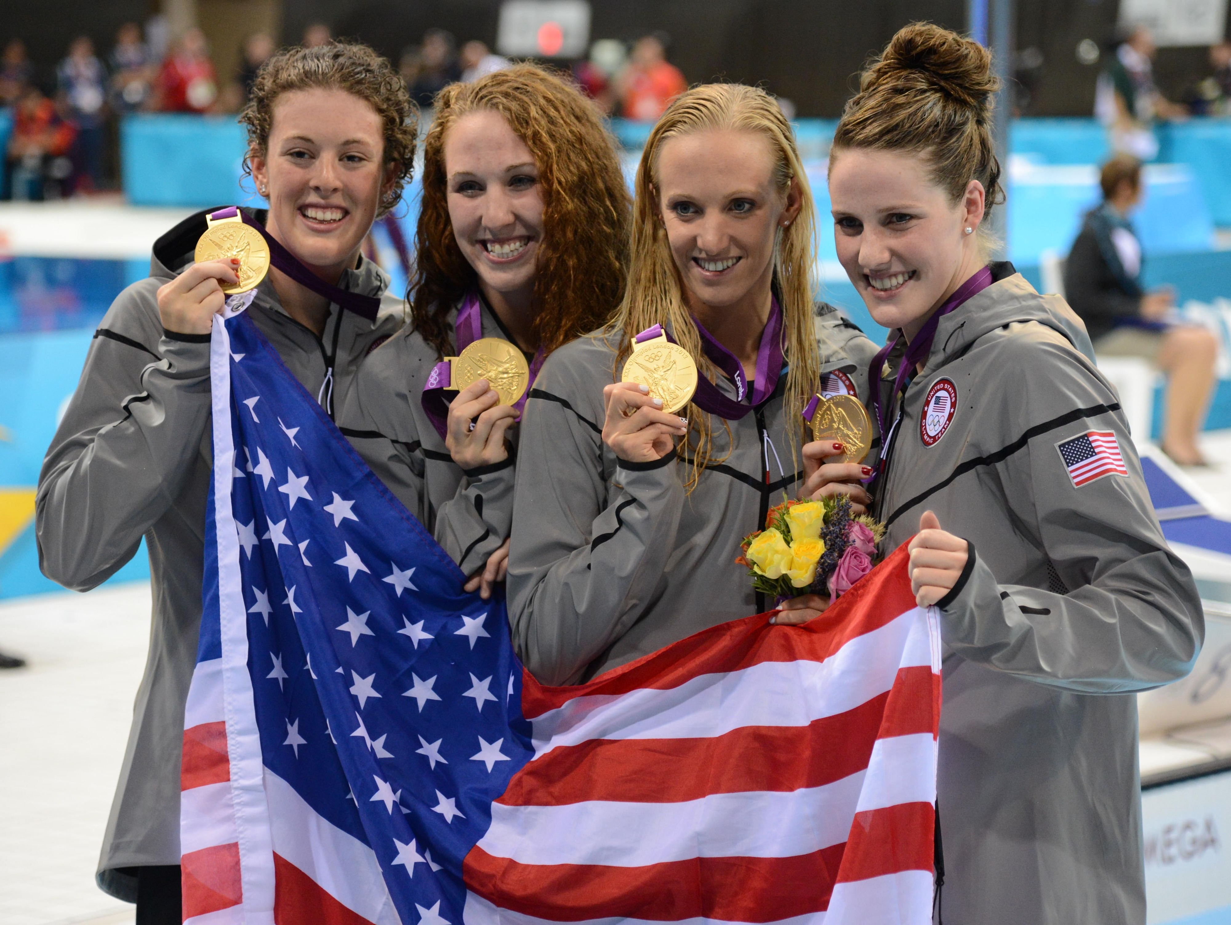 Georgia's Allison Schmitt, left, and Shannon Vreeland, second from left, were golden in the 4x200m freestyle relay.