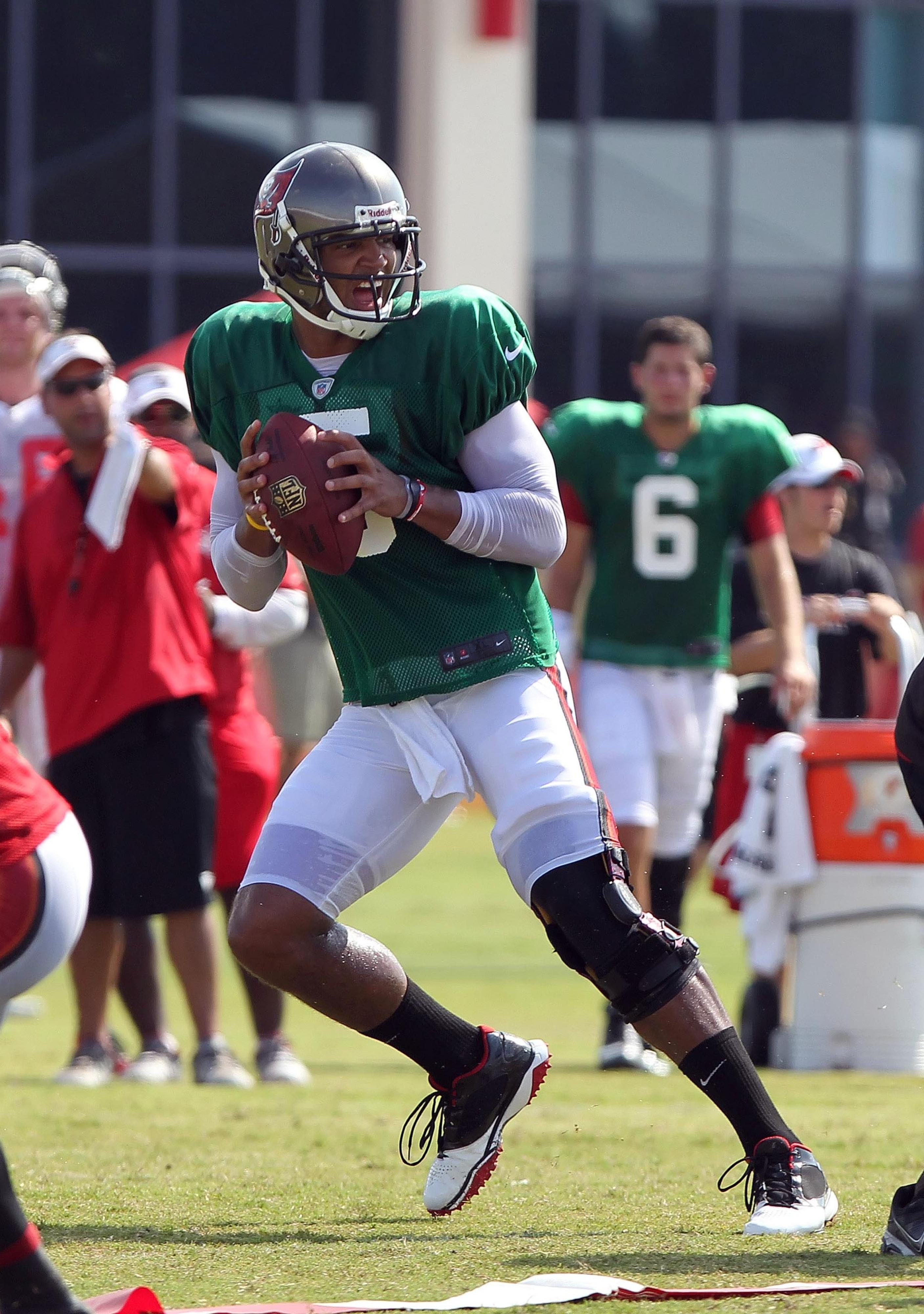 August 3, 2012; Tampa, FL, USA;  Tampa Bay Buccaneers quarterback Josh Freeman (5) drops back during training camp at One Buc Place. Mandatory Credit: Kim Klement-US PRESSWIRE