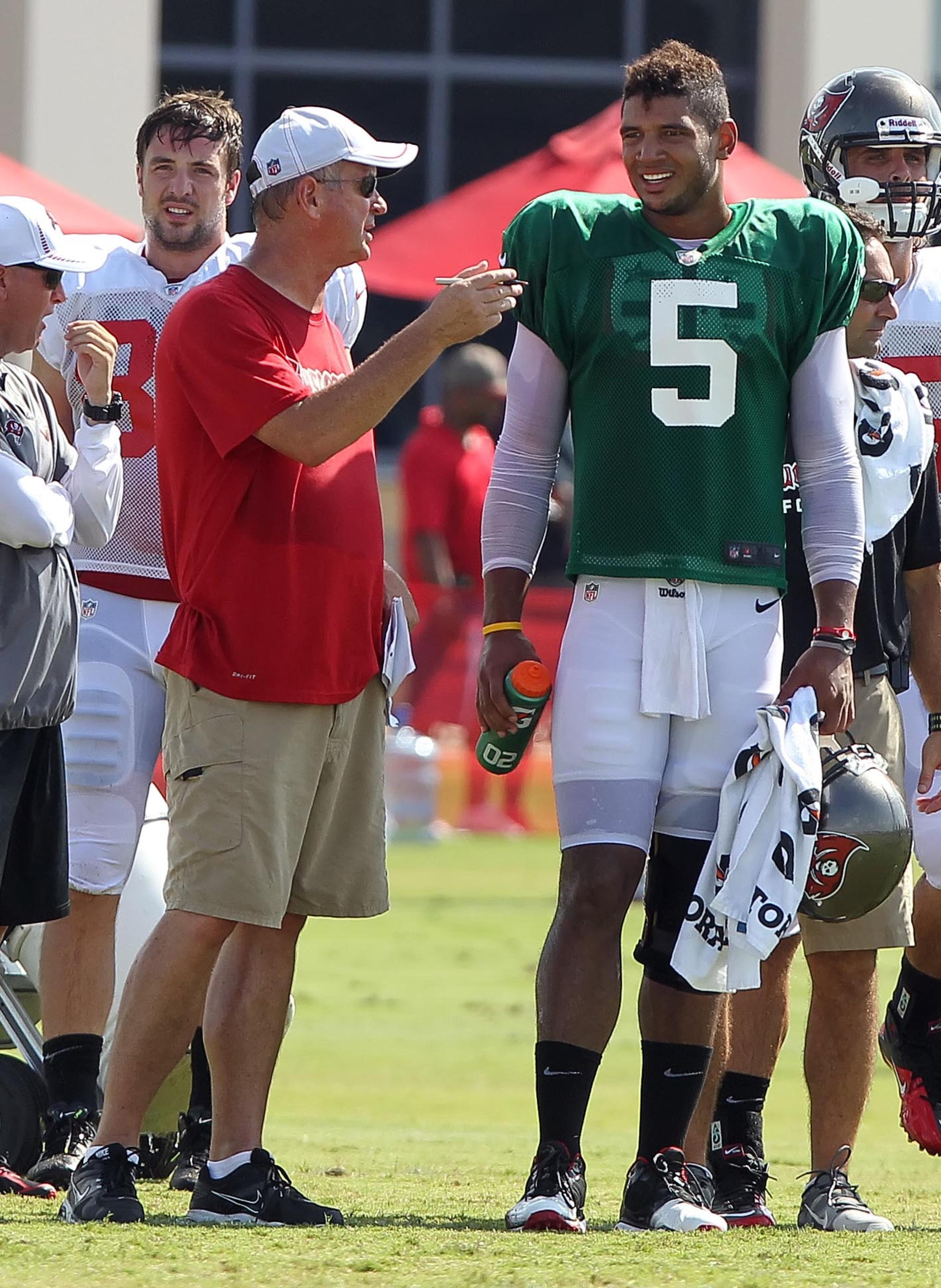 August 3, 2012; Tampa, FL, USA;  Tampa Bay Buccaneers quarterback Josh Freeman (5) talks with quarterback coach Ron Turner during training camp at One Buc Place. Mandatory Credit: Kim Klement-US PRESSWIRE