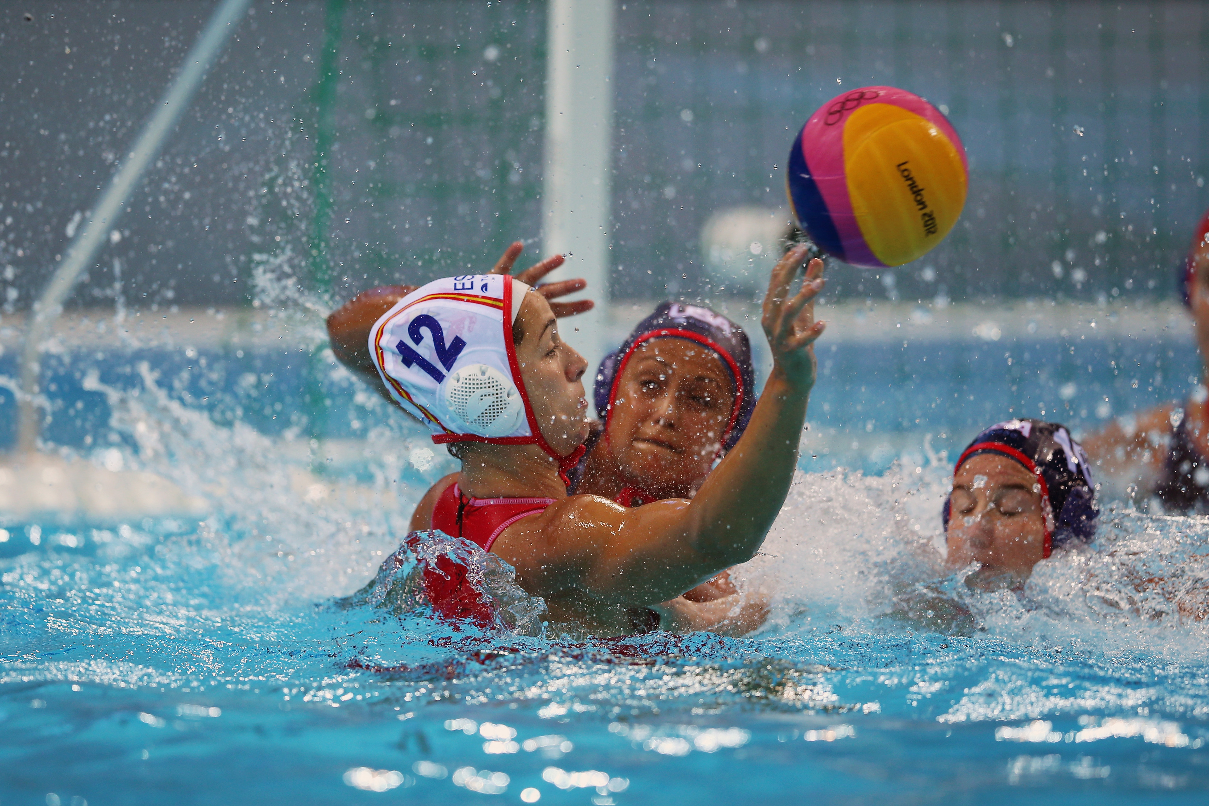 LONDON, ENGLAND - AUGUST 01:  Brenda Villa of the USA blocks Laura Lopez Ventos of Spain a on Day 5 of the London 2012 Olympics at Water Polo Arena on August 1, 2012 in London, England.  (Photo by Jeff J Mitchell/Getty Images)