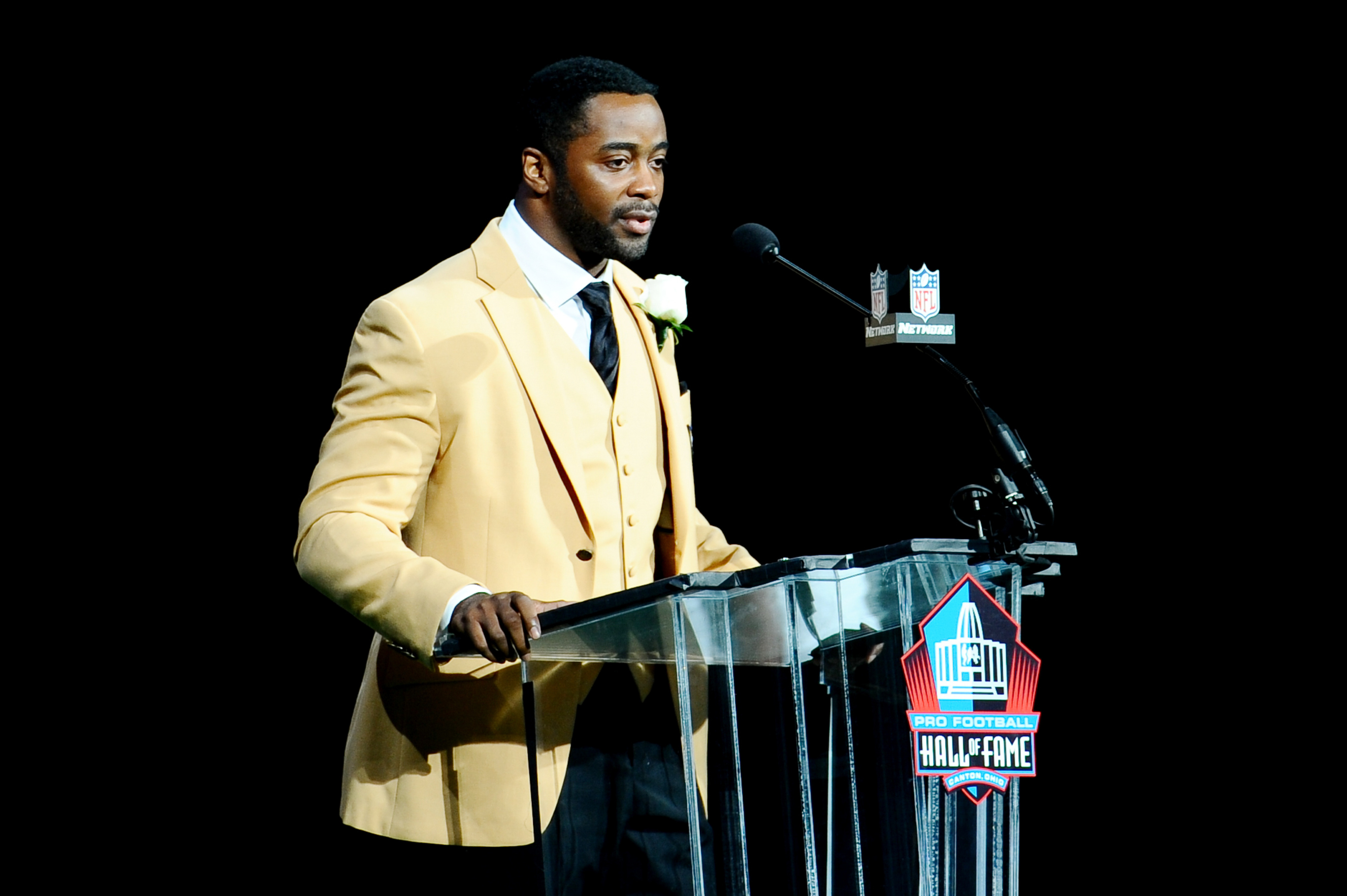Aug 4, 2012; Canton, OH, USA; Curtis Martin speaks at the 2012 Pro Football Hall of Fame Enshrinement at Fawcett Stadium. Tim Fuller-US PRESSWIRE
