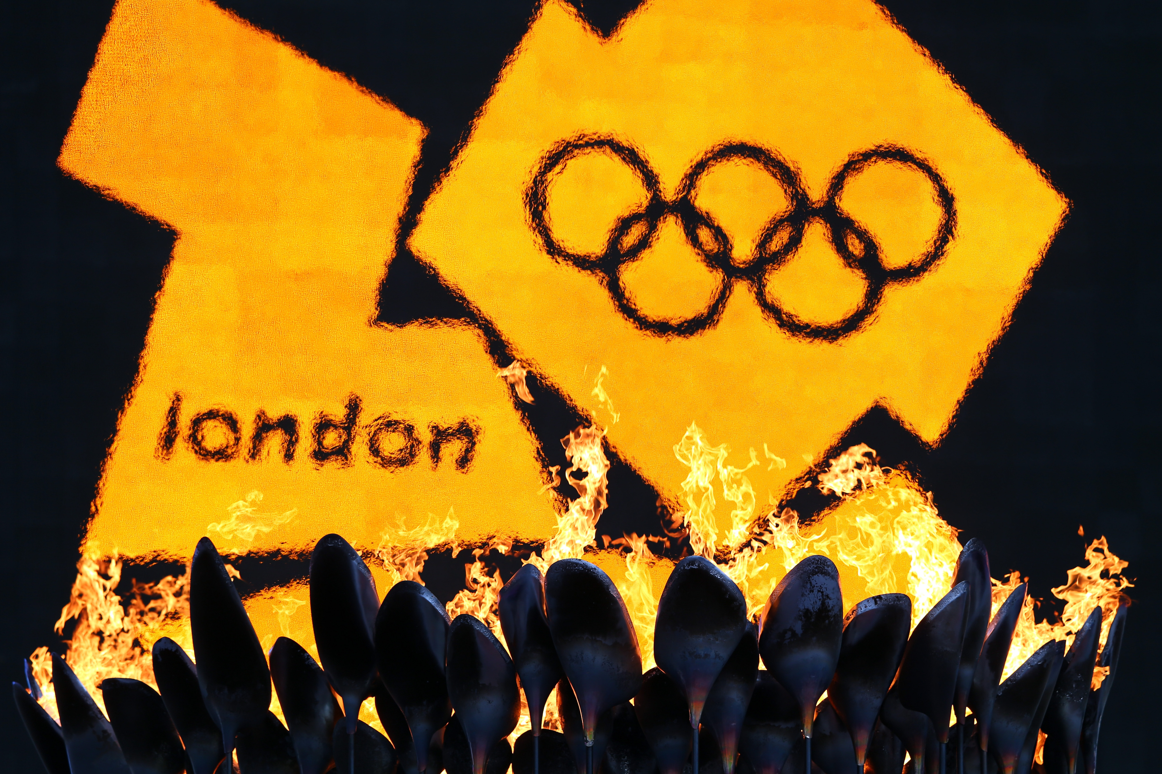 LONDON, ENGLAND - AUGUST 03:  The 2012 logo is seen as the Olympic Cauldron burns on Day 7 of the London 2012 Olympic Games at Olympic Stadium on August 3, 2012 in London, England.  (Photo by Michael Steele/Getty Images)