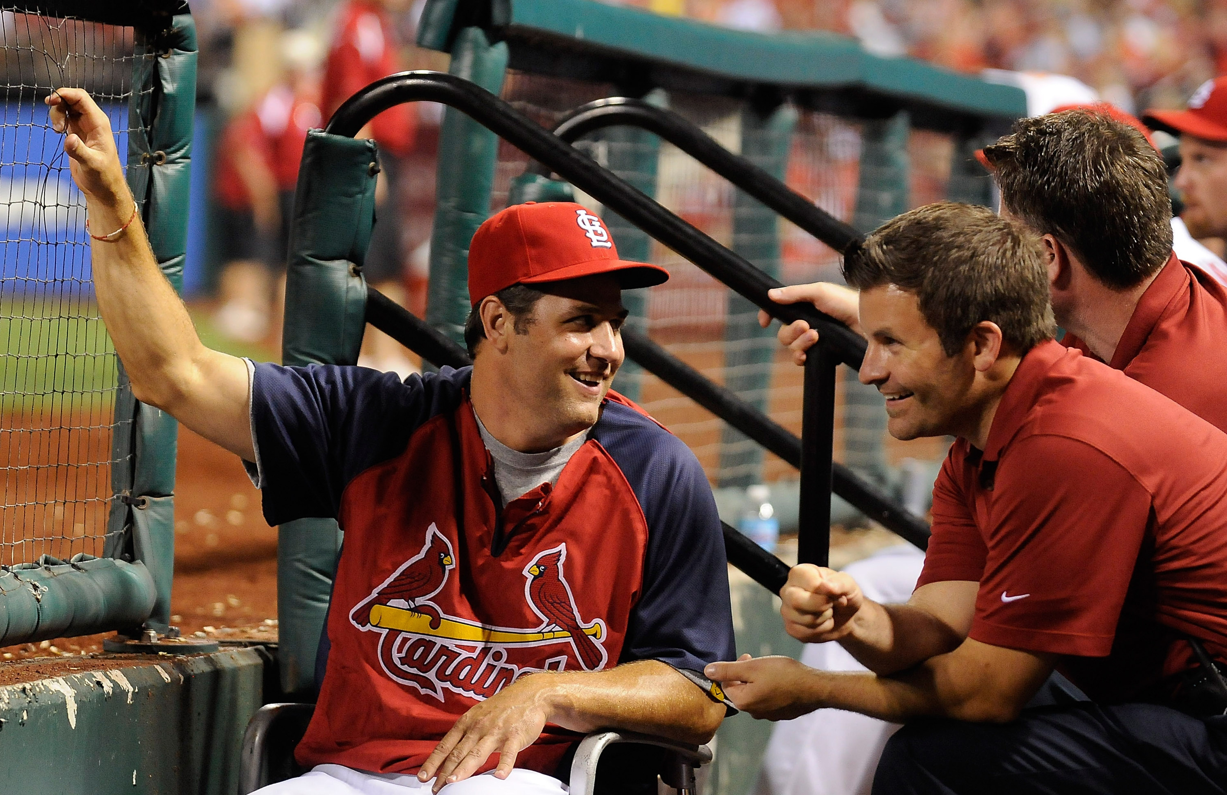 ST. LOUIS, MO - AUGUST 3: Lance Berkman #12 of the St. Louis Cardinals talks with trainers during a game against the Milwaukee Brewers at Busch Stadium on August 3, 2012 in St. Louis, Missouri. (Photo by Jeff Curry/Getty Images)