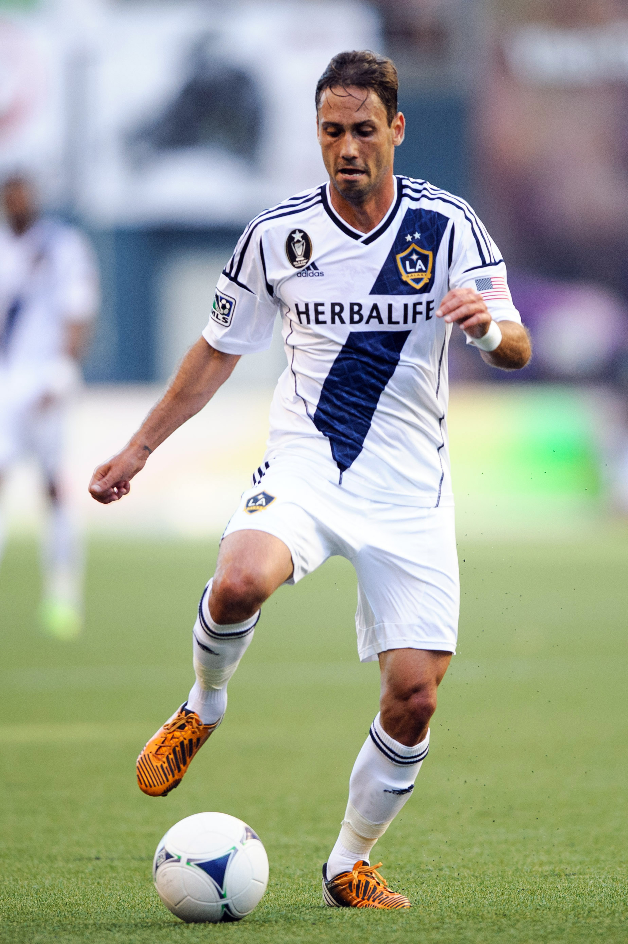 Aug 5, 2012; Seattle, WA, USA; LA Galaxy midfielder Marcelo Sarvas (8) moves the ball during the game against the Seattle Sounders FC at CenturyLink Field. Seattle defeated Los Angeles 4-0.  Mandatory Credit: Steven Bisig-US PRESSWIRE