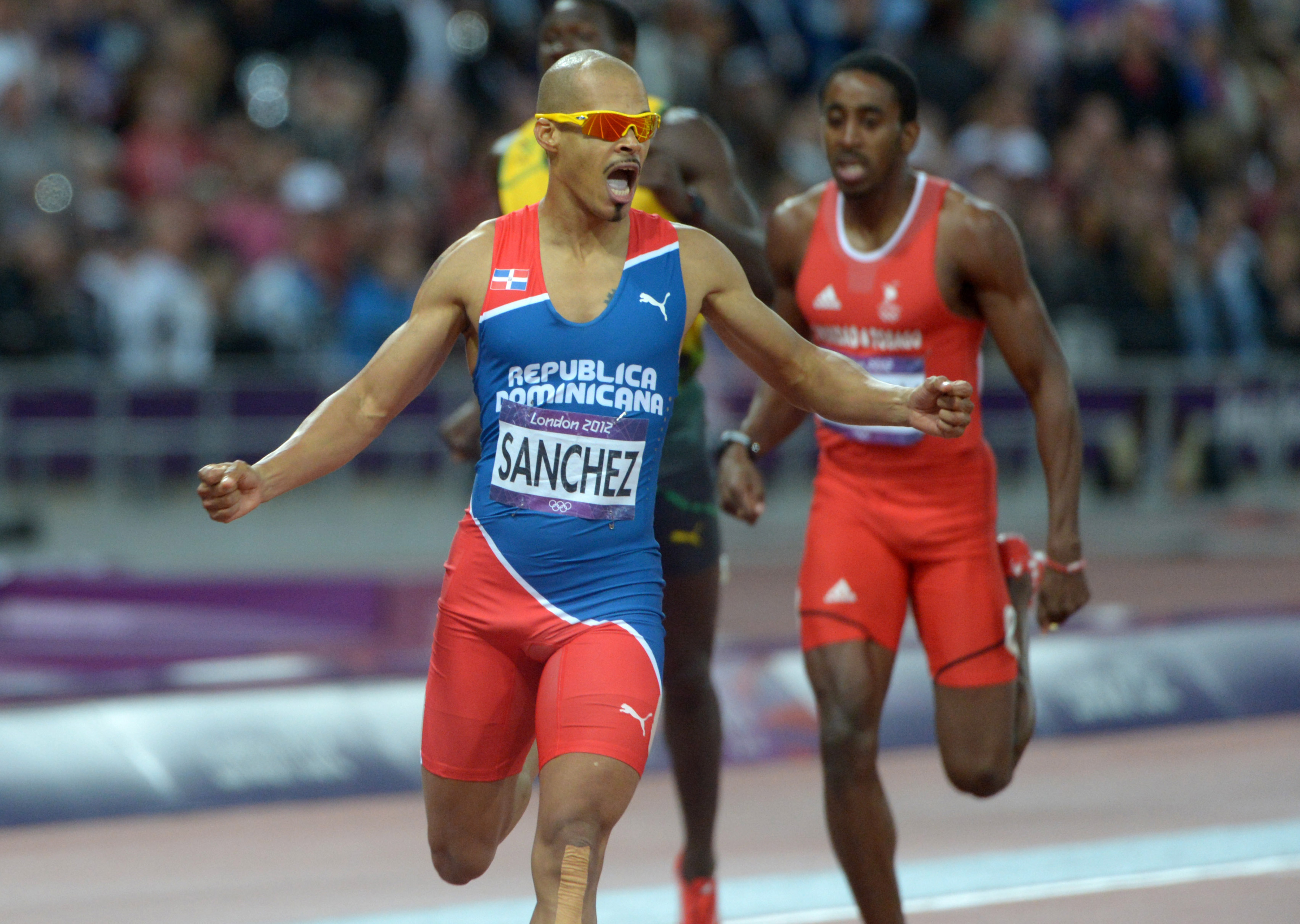 Aug 6, 2012; London, United Kingdom; Felix Sanchez (DOM) reacts after winning the mens 400m hurdles in 47.63 during the London 2012 Olympic Games at Olympic Stadium. Mandatory Credit: Kirby Lee-USA TODAY Sports
