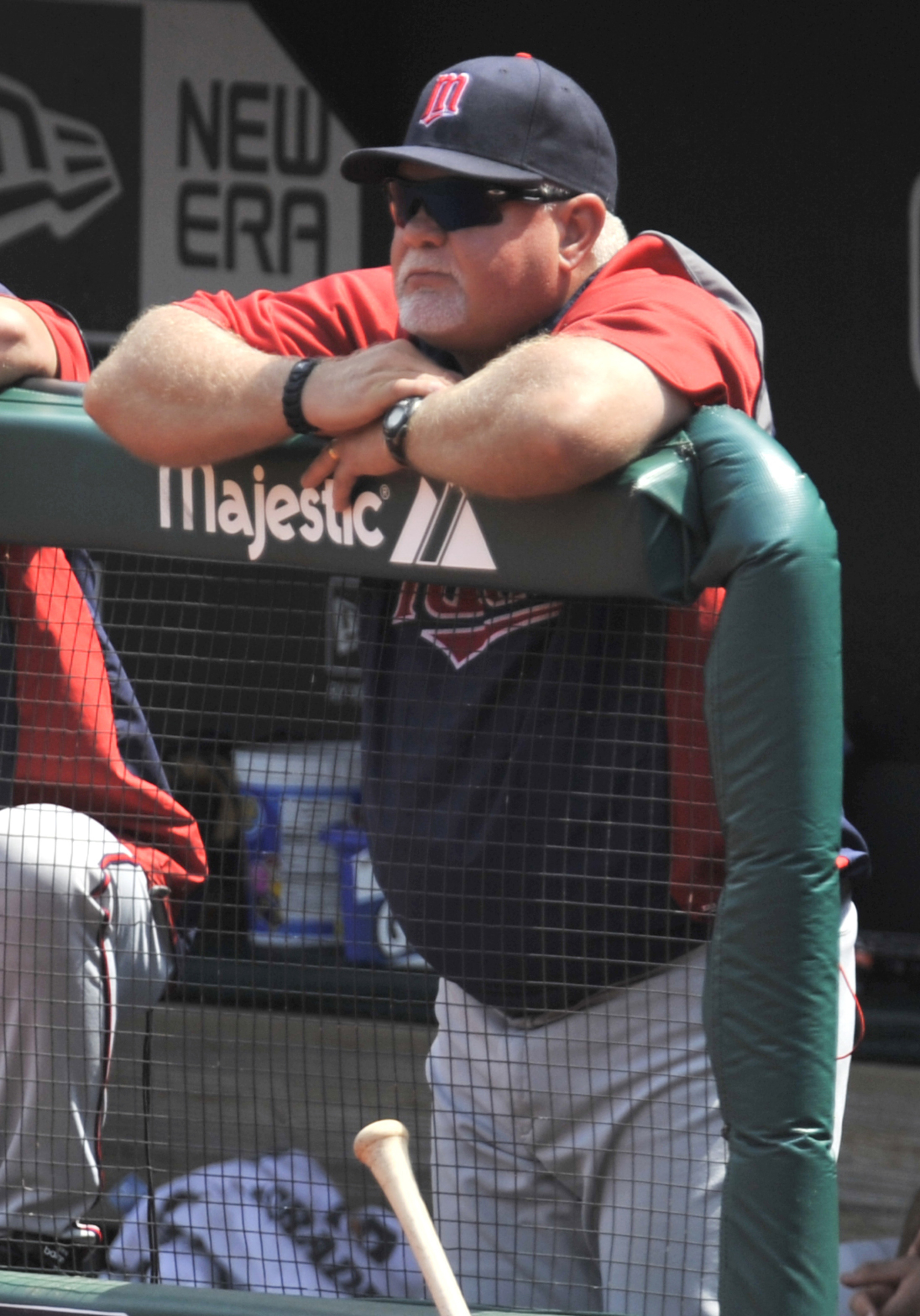 Aug 8, 2012; Cleveland, OH, USA; Minnesota Twins manager Ron Gardenhire (35) watches the action in the third inning against the Cleveland Indians at Progressive Field. Mandatory Credit: David Richard-US PRESSWIRE