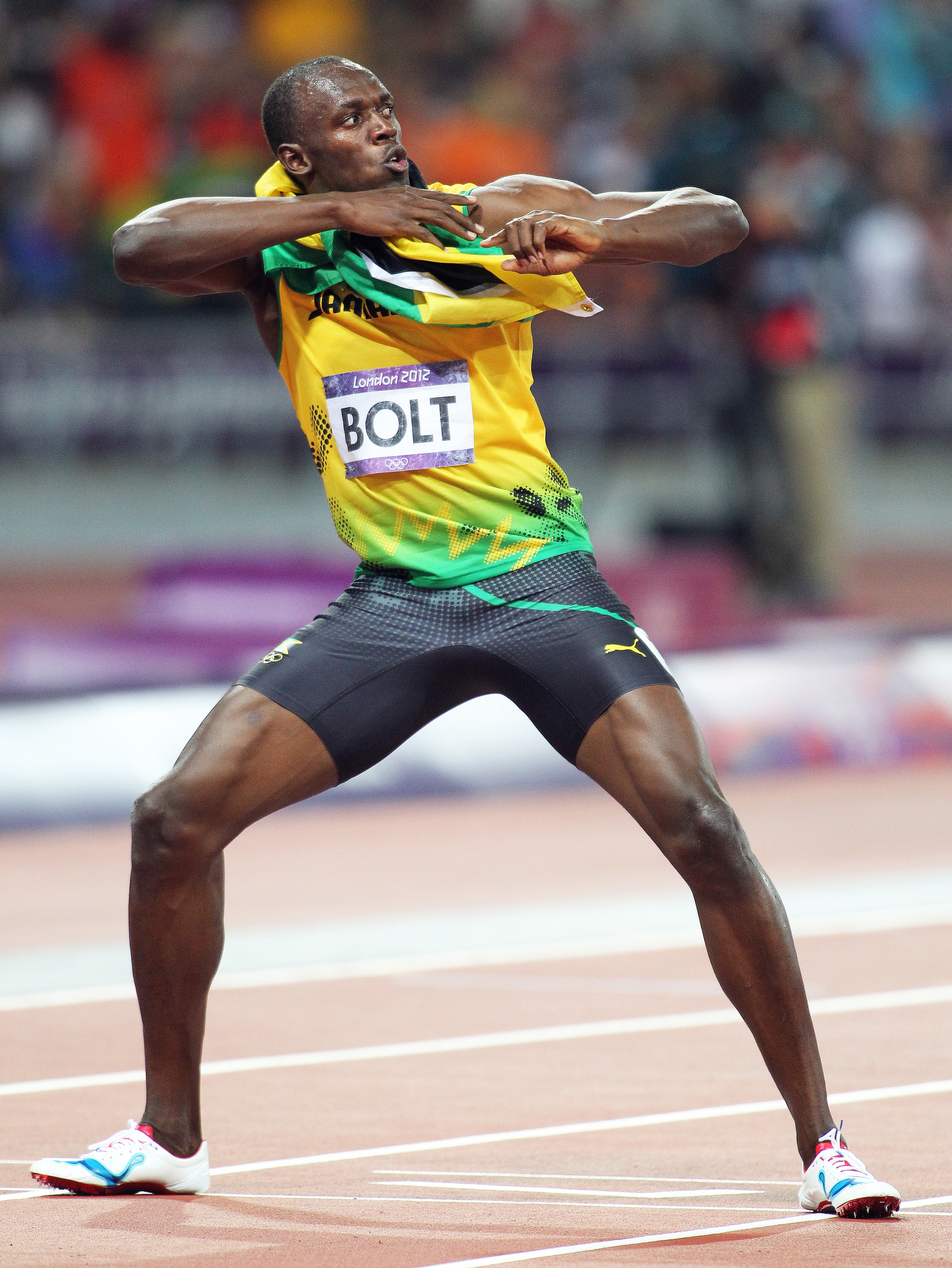 Aug 9, 2012; London, United Kingdom; Usain Bolt (JAM) celebrates after winning the mens 200m in 19.32 during the London 2012 Olympic Games at Olympic Stadium. Mandatory Credit: Kirby Lee-USA TODAY Sports