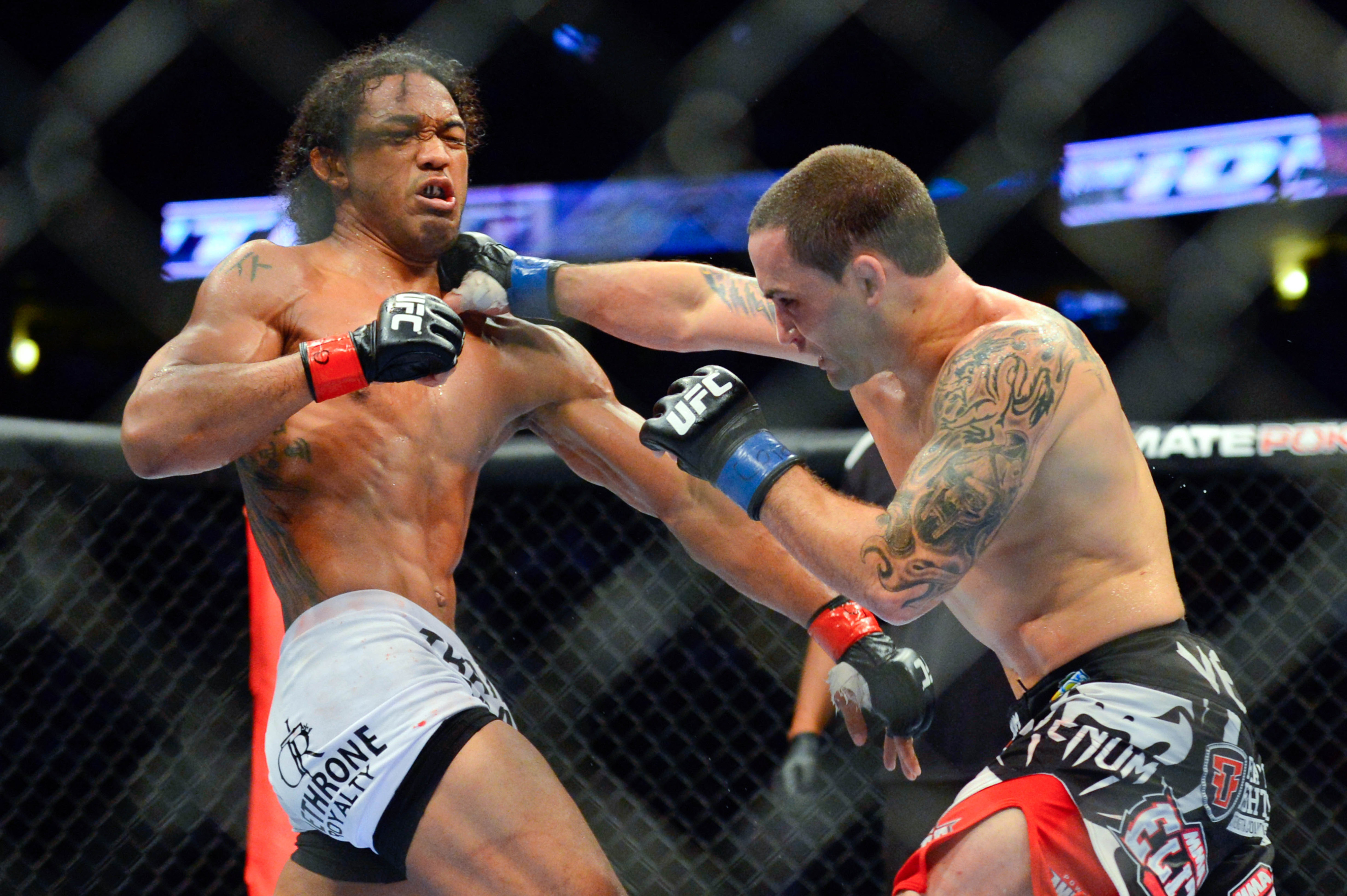 August 11, 2012; Denver, CO, USA; Benson Henderson (left) fights Frankie Edgar (right) during UFC 150 at the Pepsi Center. Ron Chenoy-US PRESSWIRE
