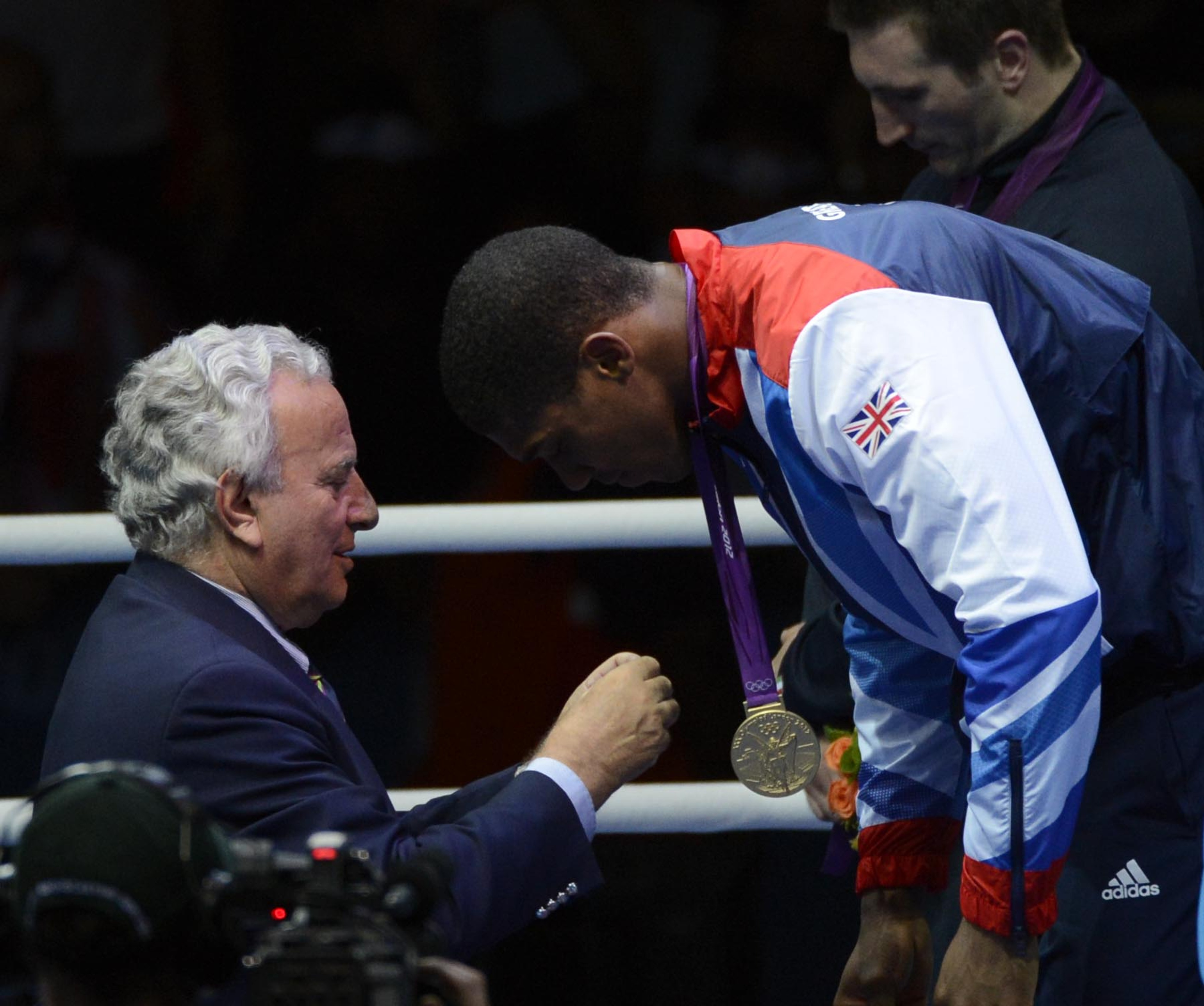 Aug 12, 2012; London, United Kingdom; Anthony Joshua (GBR) receives his medal after winning the men's super heavy weight final bout during the London 2012 Olympic Games at ExCeL - South Arena 2.