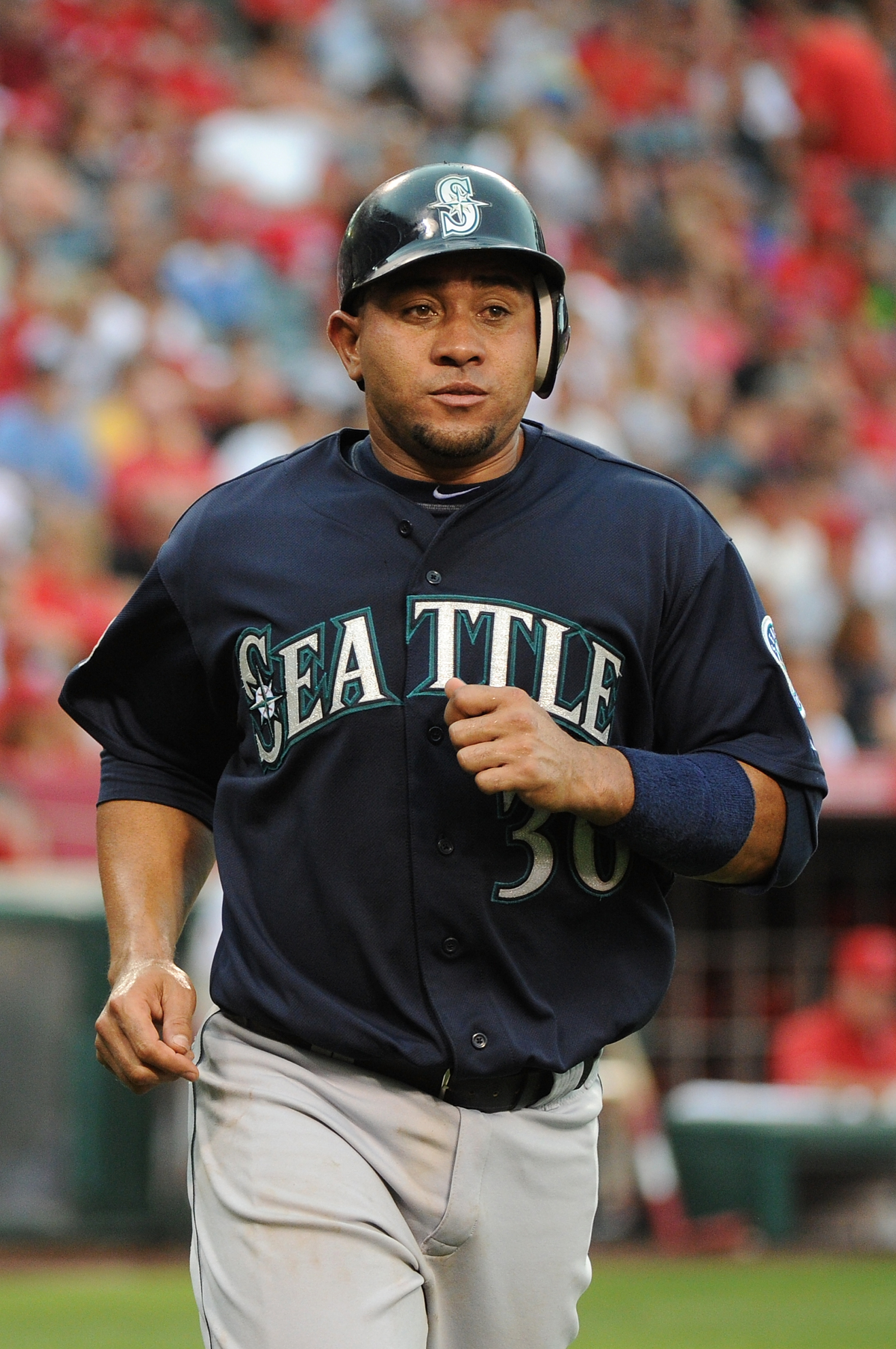 ANAHEIM, CA - AUGUST 11: Miguel Olivo #30 of the Seattle Mariners scores in the fourth inning against the Los Angeles Angels of Anaheim at Angel Stadium of Anaheim on August 11, 2012 in Anaheim, California. (Photo by Lisa Blumenfeld/Getty Images)