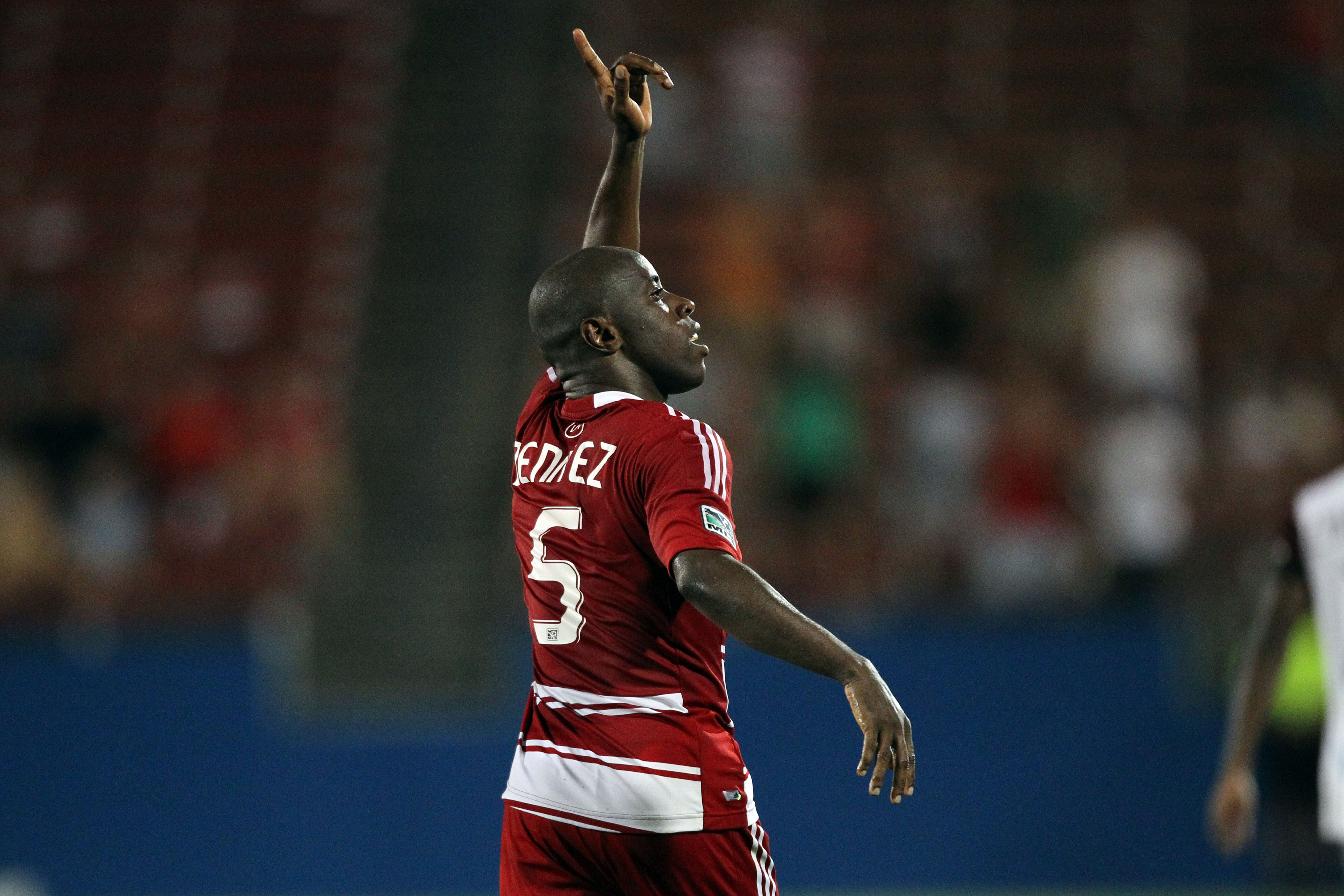 FRISCO, TX - AUGUST 11: Jair Benitez #5 of FC Dallas points to the crowd and celebrates his goal against the Colorado Rapids at FC Dallas Stadium on August 11, 2012 in Frisco, Texas. (Photo by Layne Murdoch/Getty Images)