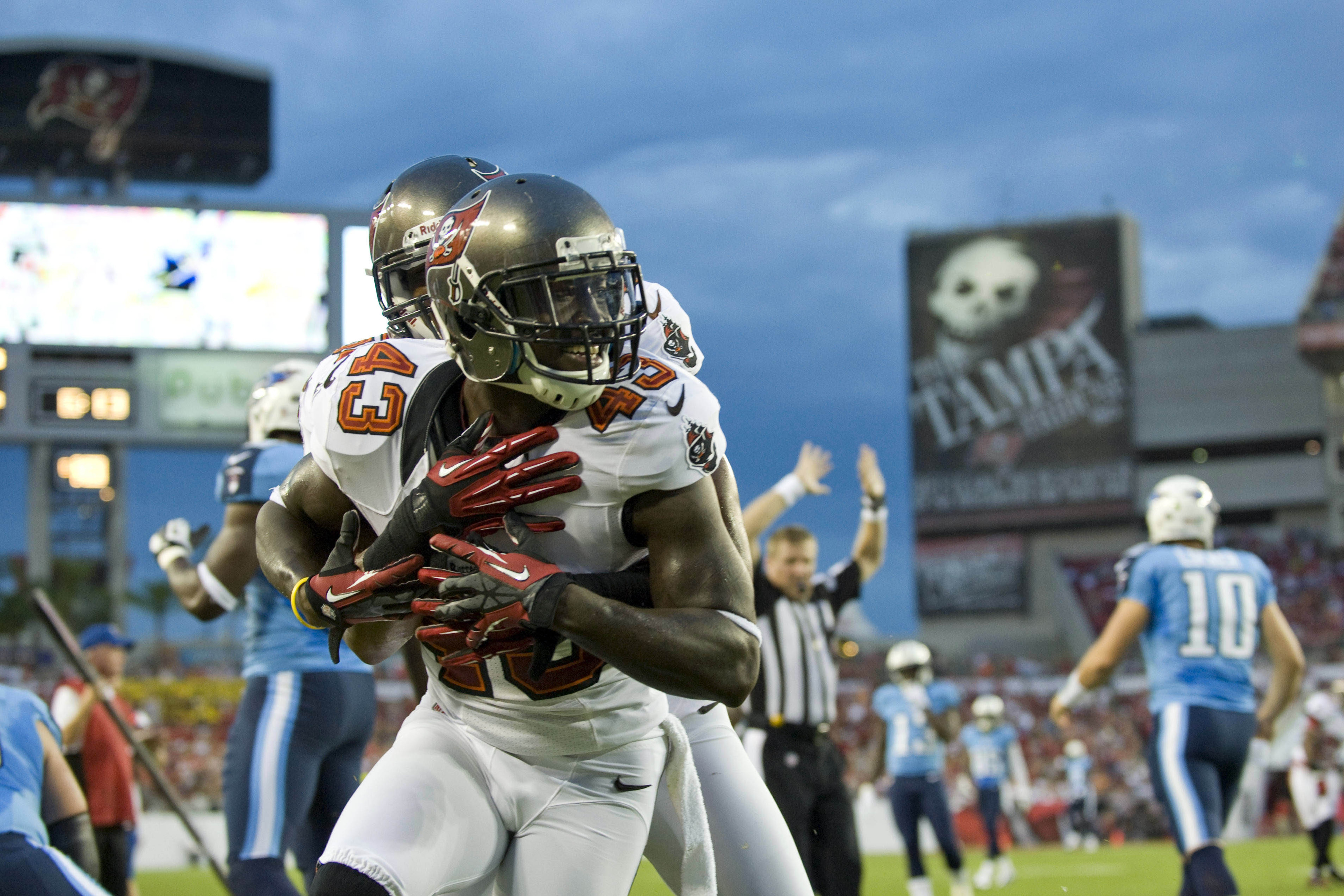 August 17, 2012; Tampa, FL, USA; Tampa Bay Buccaneers safety Ahmad Black (43) is congratulated by a teammate after an interception against the Tennessee Titans at Raymond James Stadium.  Mandatory Credit: Jeff Griffith-US PRESSWIRE
