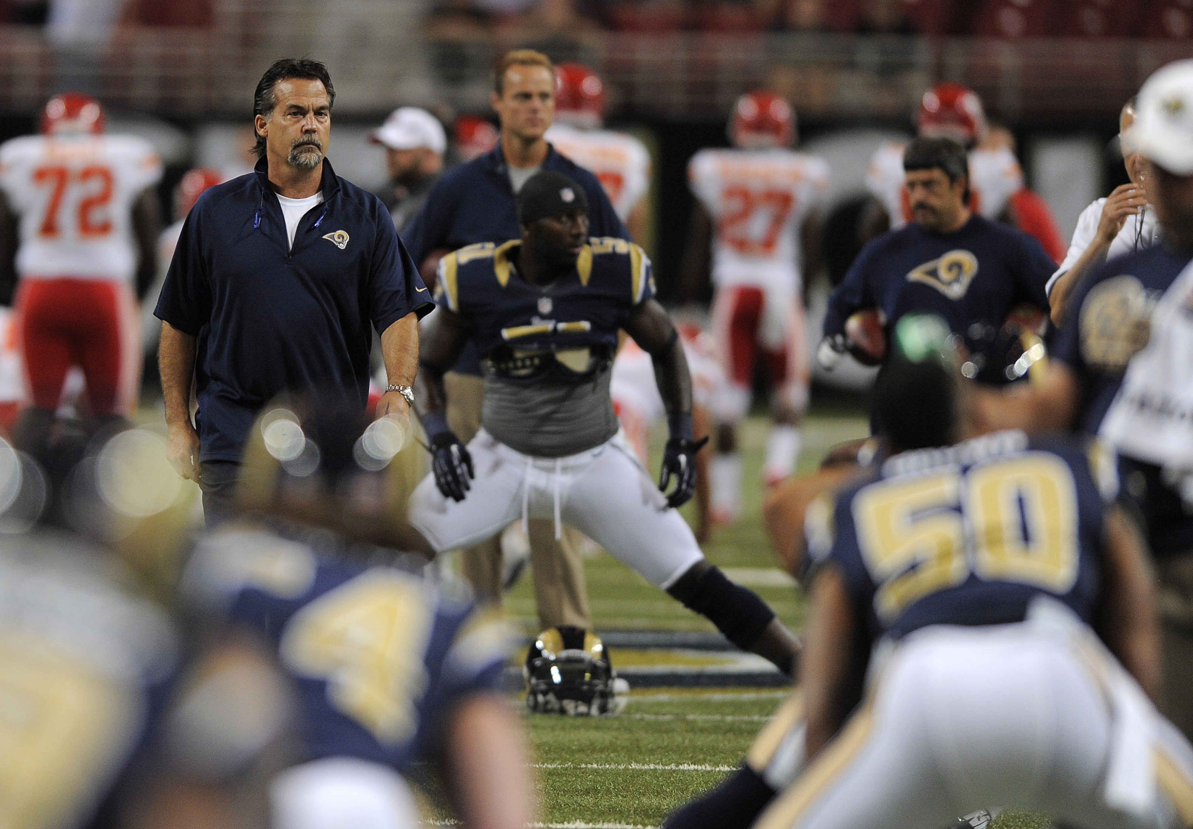 August 18, 2012; St. Louis, MO, USA; St. Louis Rams head coach Jeff Fisher looks on as his team warms up before a game against the Kansas City Chiefs at the Edward Jones Dome. Mandatory Credit: Jeff Curry-US PRESSWIRE