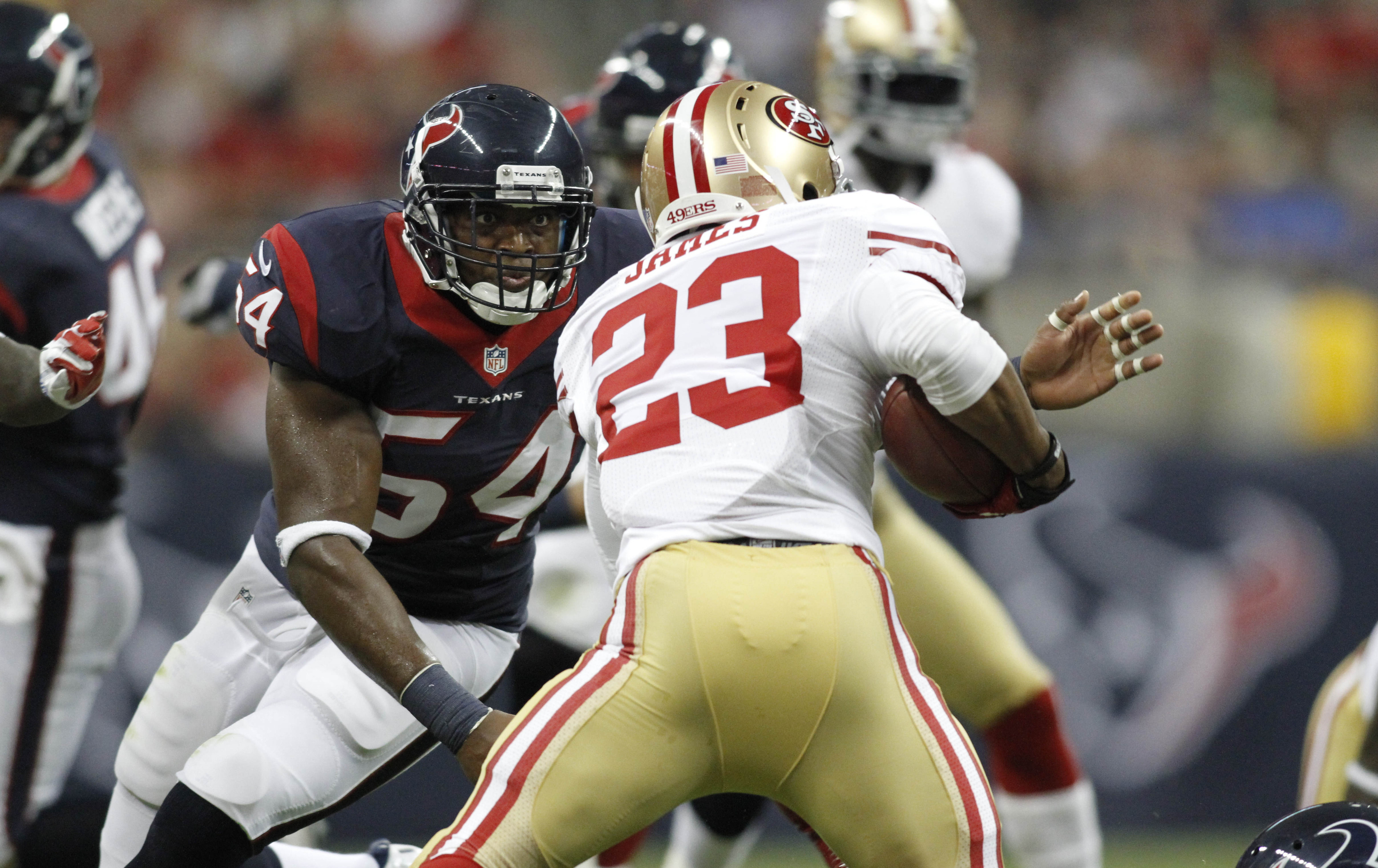 Aug 18, 2012; Houston, TX, USA; Houston Texans linebacker Mister Alexander (54) tackles San Francisco 49ers running back LaMichael James (23) in the first quarter at Reliant Stadium. Mandatory Credit: Brett Davis-US PRESSWIRE