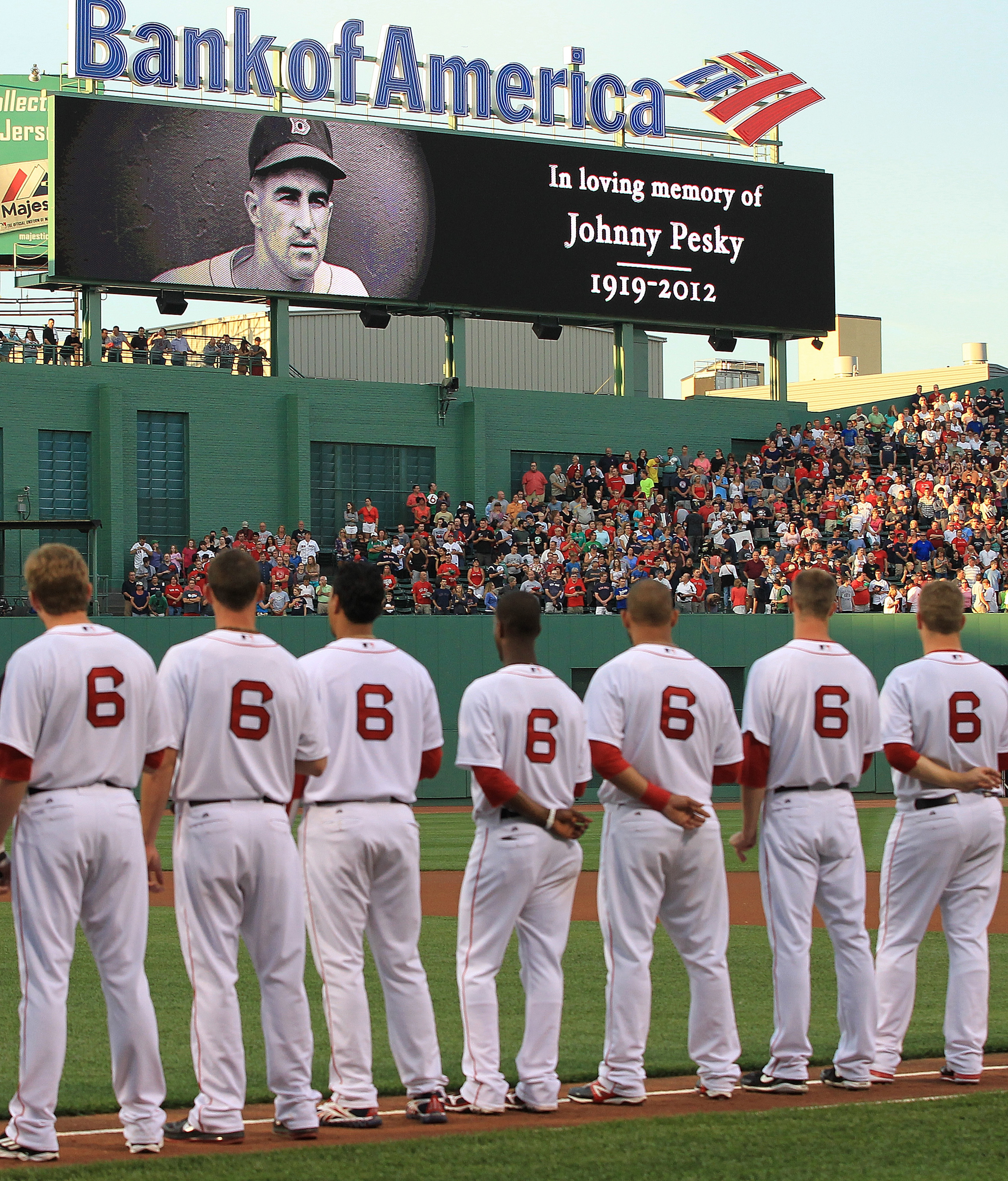FOXBORO, MA:  Red Sox players line up wearing the number six in memory of former Red Sox player Johnny Pesky, who recently died, before a game with the Los Angeles Angels at Fenway Park in Boston, Massachusetts.  (Photo by Jim Rogash/Getty Images)