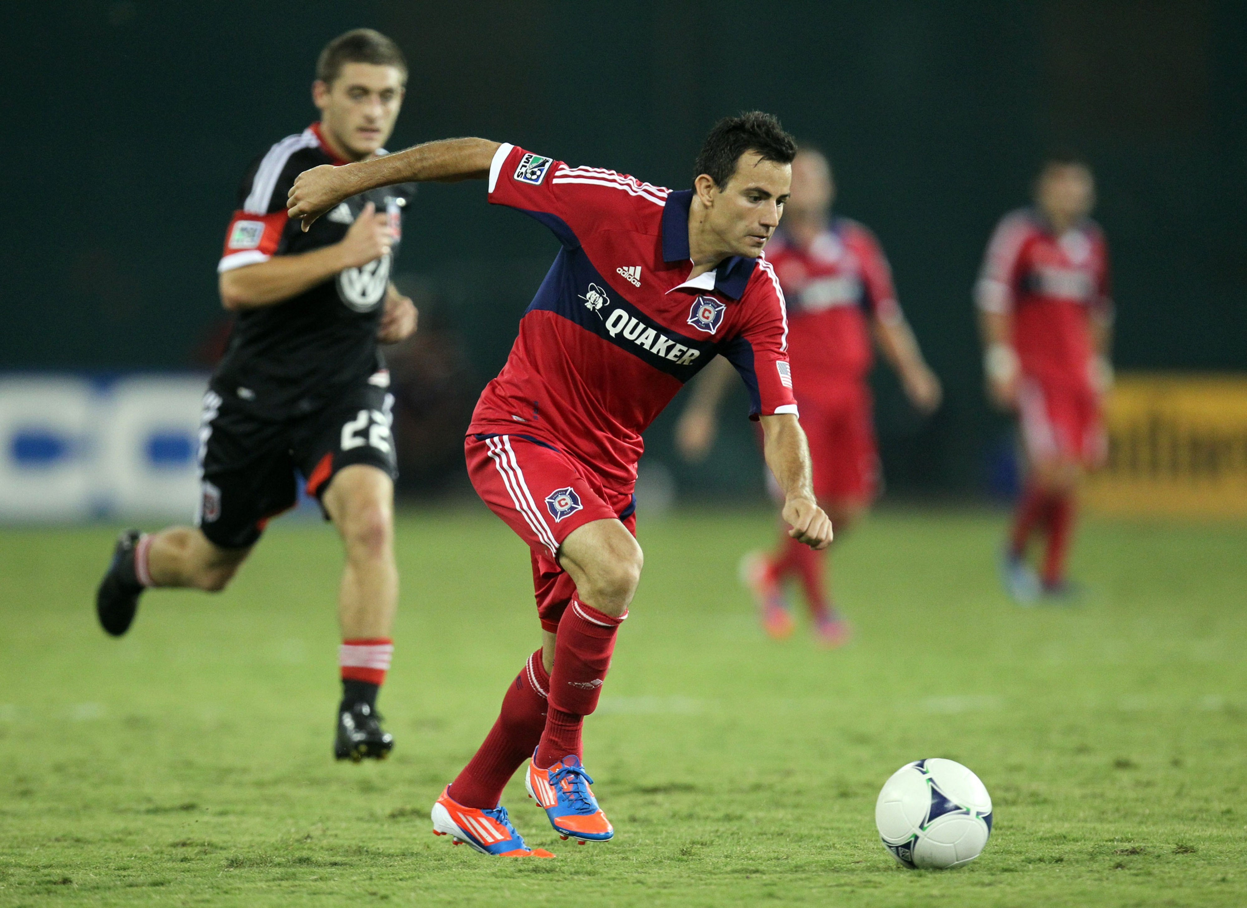 WASHINGTON, DC - AUGUST 22:  Marco Pappa #16 of the Chicago Fire competes for the ball with Chris Korb #22 of D.C. United at RFK Stadium on August 22, 2012 in Washington, DC.(Photo by Ned Dishman/Getty Images)