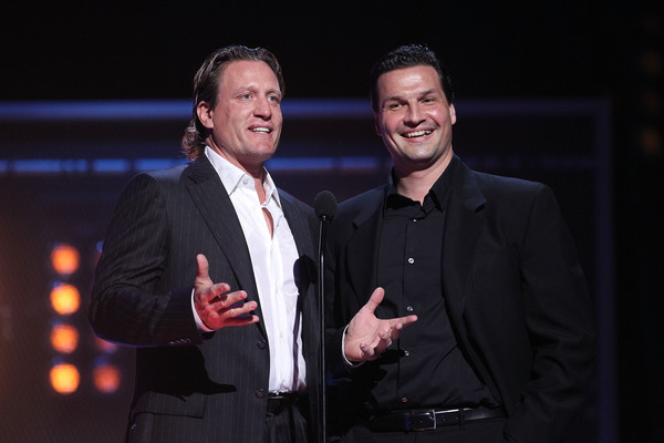 LAS VEGAS - JUNE 23:  (L-R) Presenters Jeremy Roenick and Eddie Olczyk speak on stage during the 2010 NHL Awards at the Palms Casino Resort on June 23, 2010 in Las Vegas, Nevada.  (Photo by Bruce Bennett/Getty Images for NHLI)