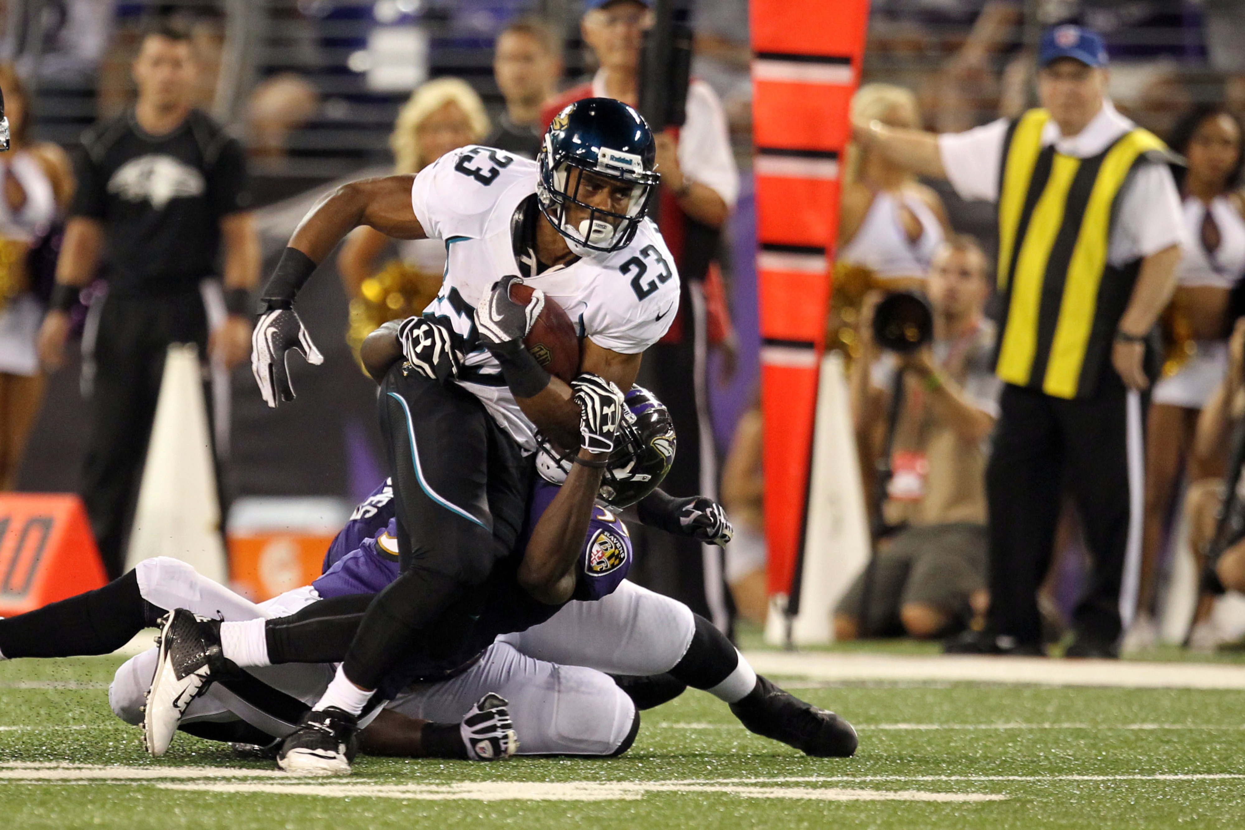 August 23, 2012; Baltimore, MD, USA; Jacksonville Jaguars running back Rashad Jennings (23) runs for a gain against the Baltimore Ravens at M&T Bank Stadium. Mandatory Credit: Mitch Stringer-US PRESSWIRE