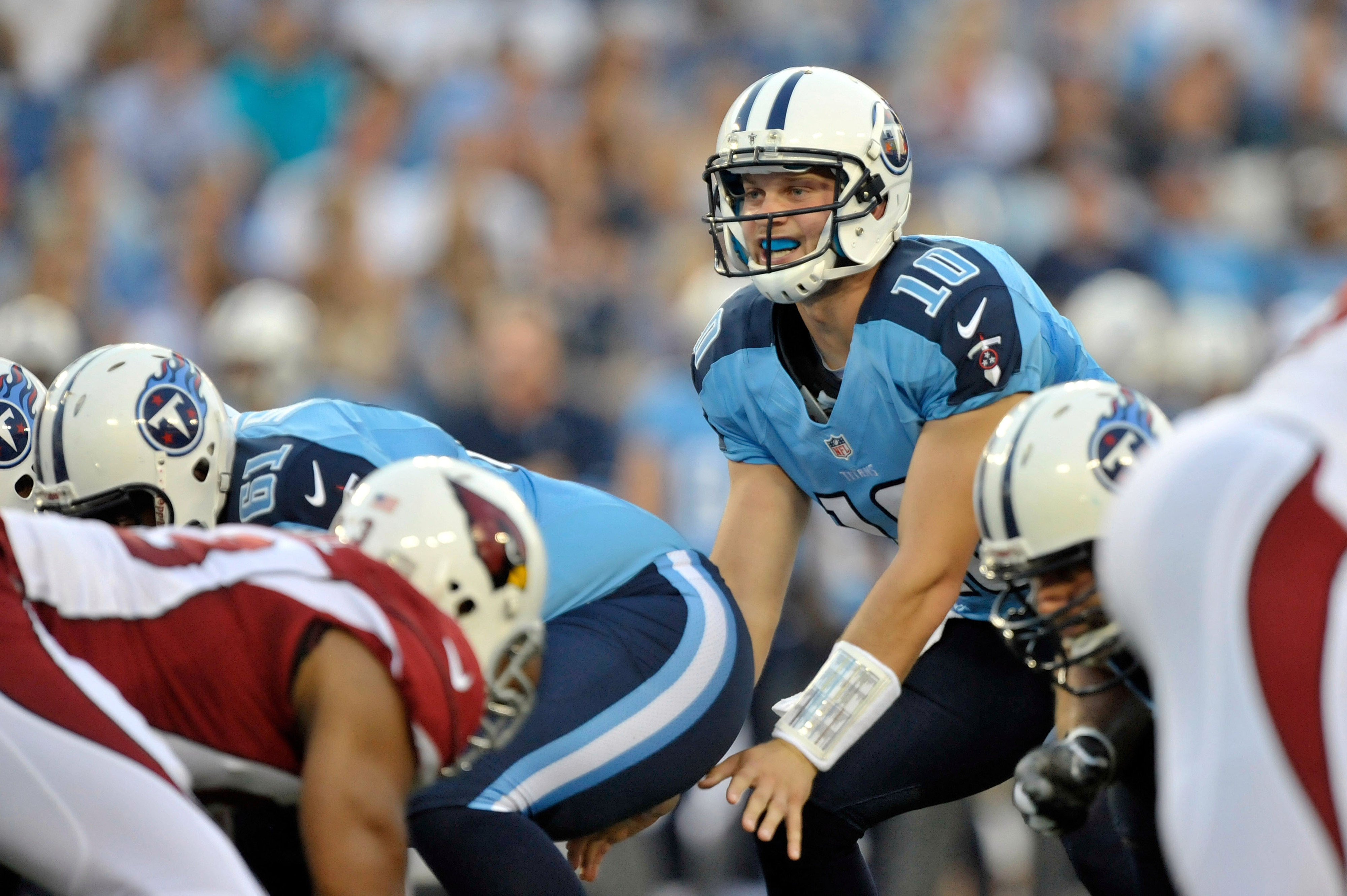 Aug 23, 2012; Nashville, TN, USA; Tennessee Titans quarterback Jake Locker (10) takes the snap against the Arizona Cardinals during the first half at LP Field. Mandatory Credit: Jim Brown-US PRESSWIRE