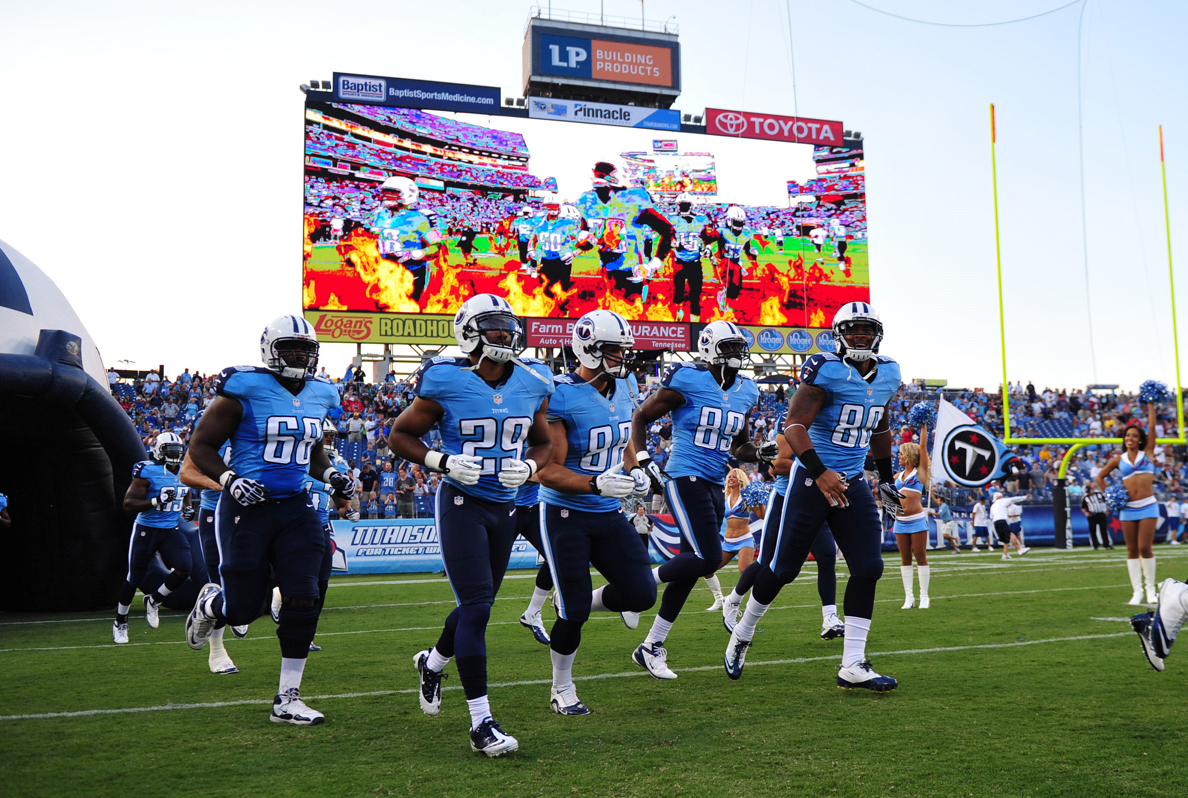 Aug 23, 2012; Nashville, TN, USA; The Tennessee Titans take the field in front of their new Jumbotron before a game against the Arizona Cardinals at LP Field. The Titans beat the Cardinals 32-27. Mandatory credit: Don McPeak-US PRESSWIRE